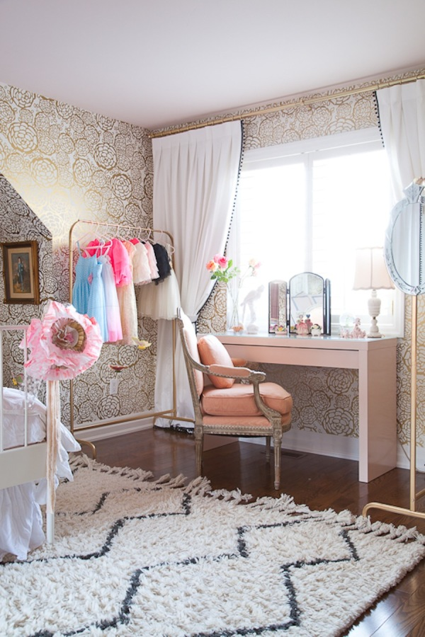 This vanity could just as easily be used as a desk in this cozy and chic little bedroom! Image via Style Me Pretty.