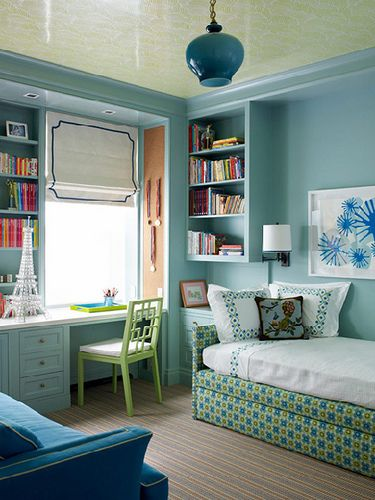 LOVE the efficiency of this girl's bedroom designed by Katie Ridder. The small space allows for a desk with library style bookshelves, a daybed with trundle AND a sofa!