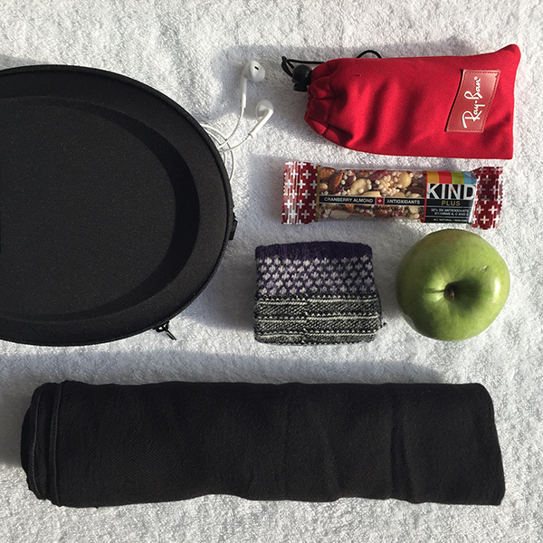 For Comfort:noise-canceling headphones, sunglasses, snacks, socks and my scarf/blanket