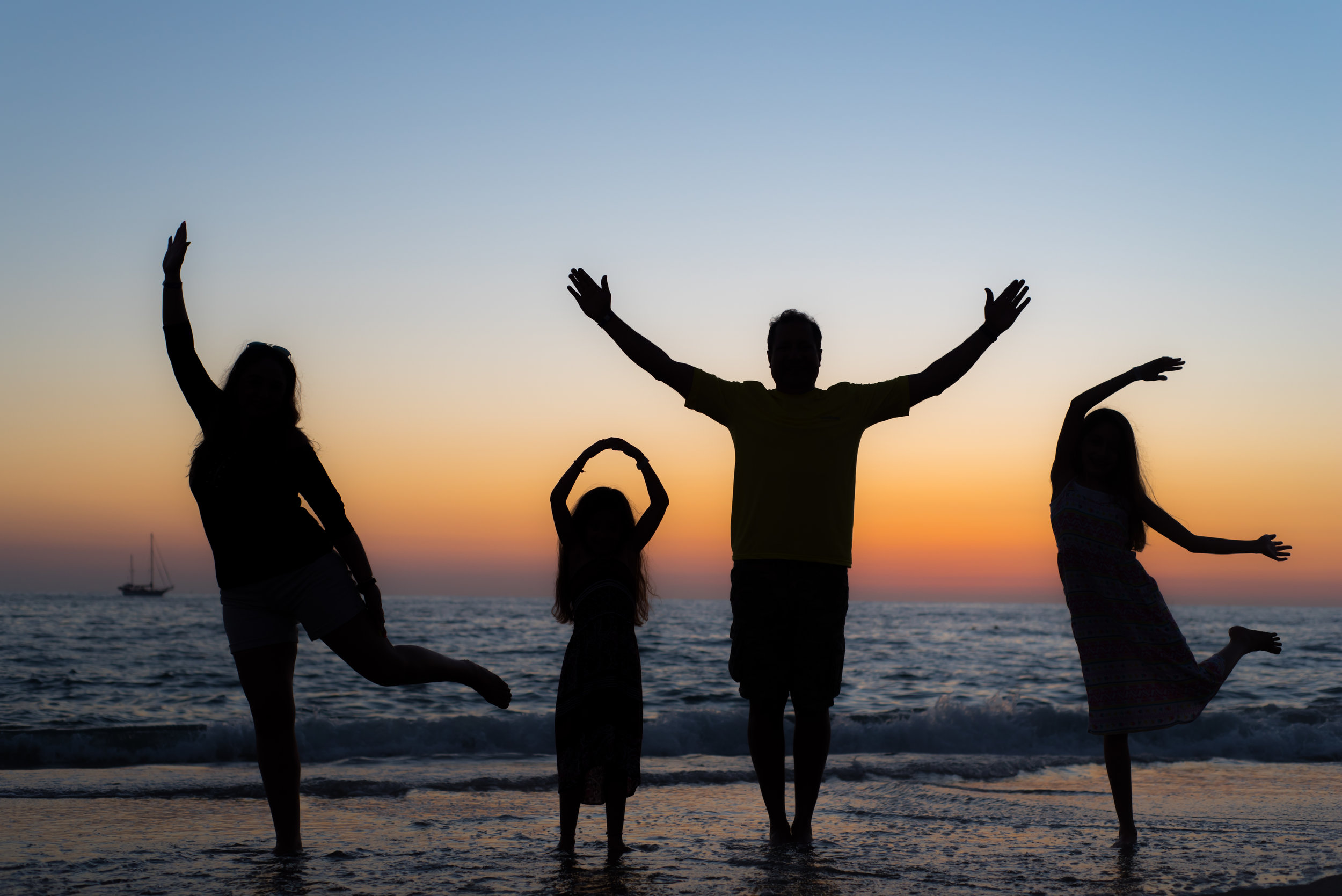 family silhouette on the beach