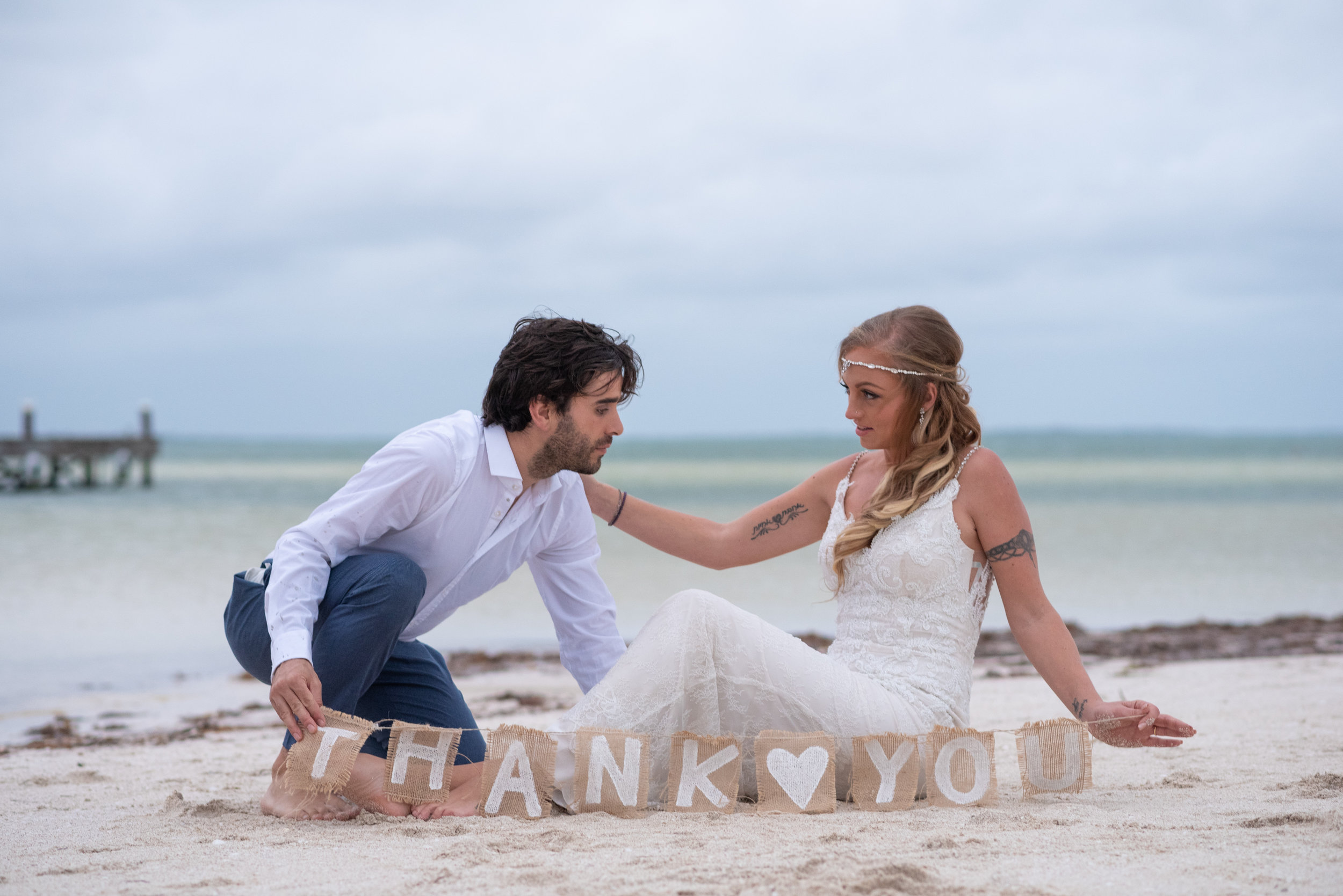 bride and groom in the shore of Holbox island in punta coco
