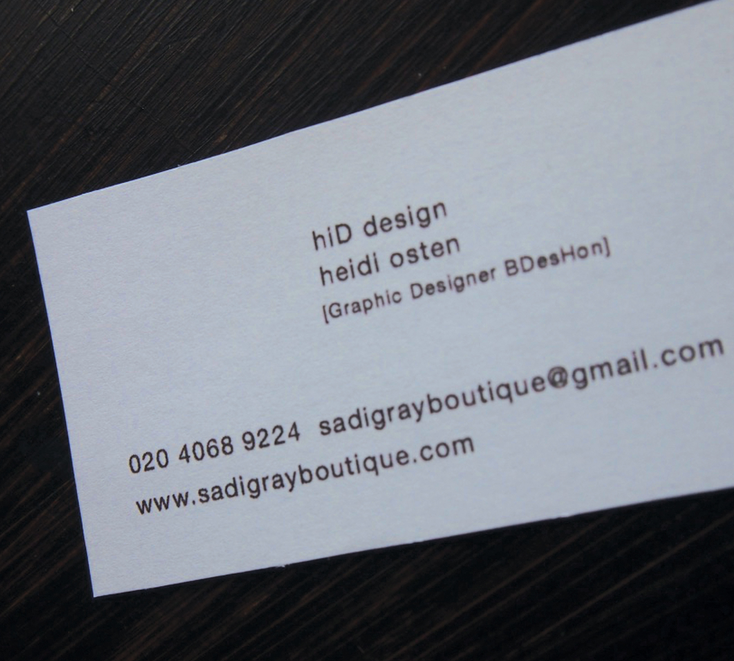 [Back of business card]