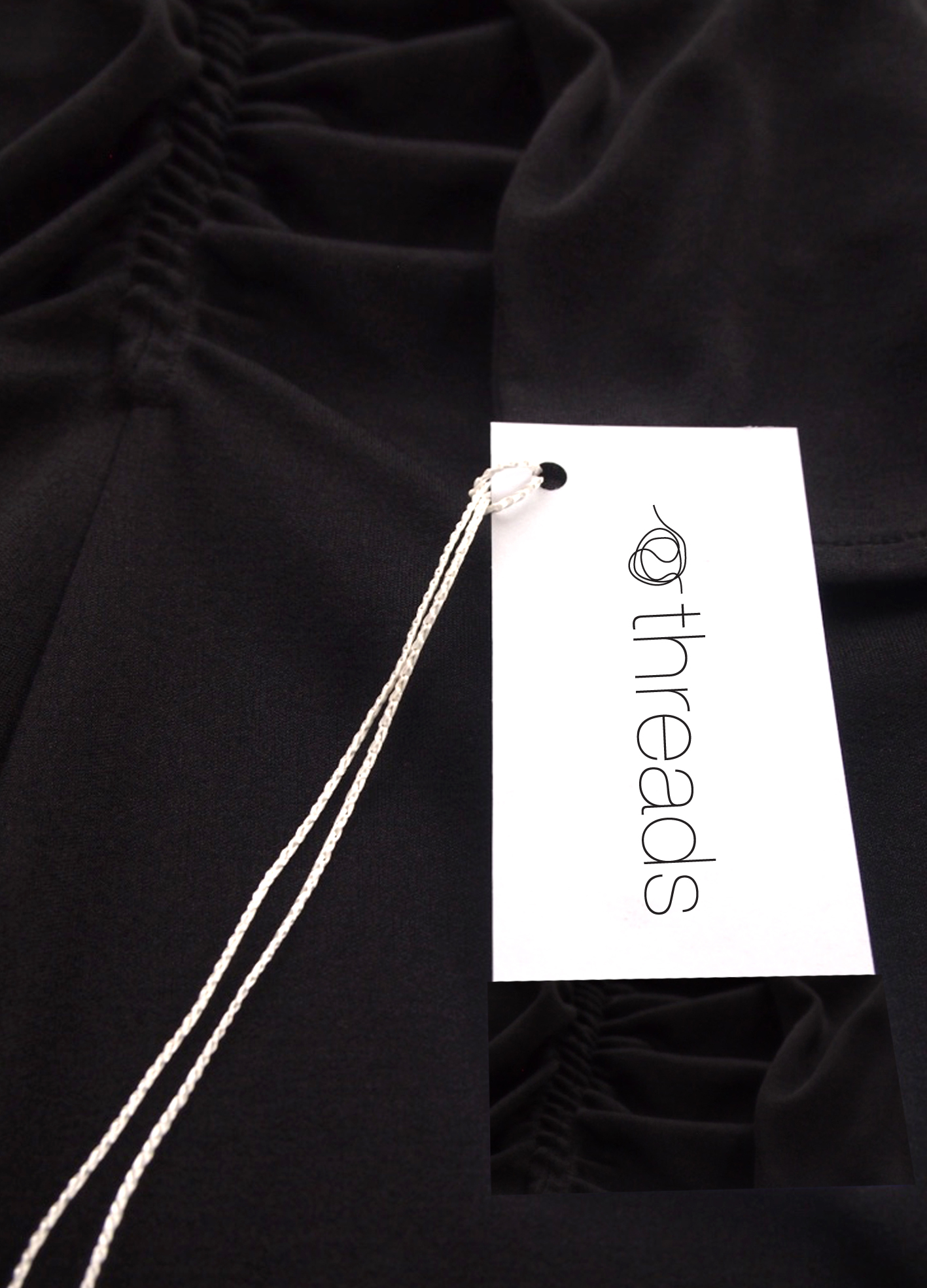 [Threads] 2013 Creation of a brand identity for Threads, a part of Sadigray Boutique. [Above front of clothing label]