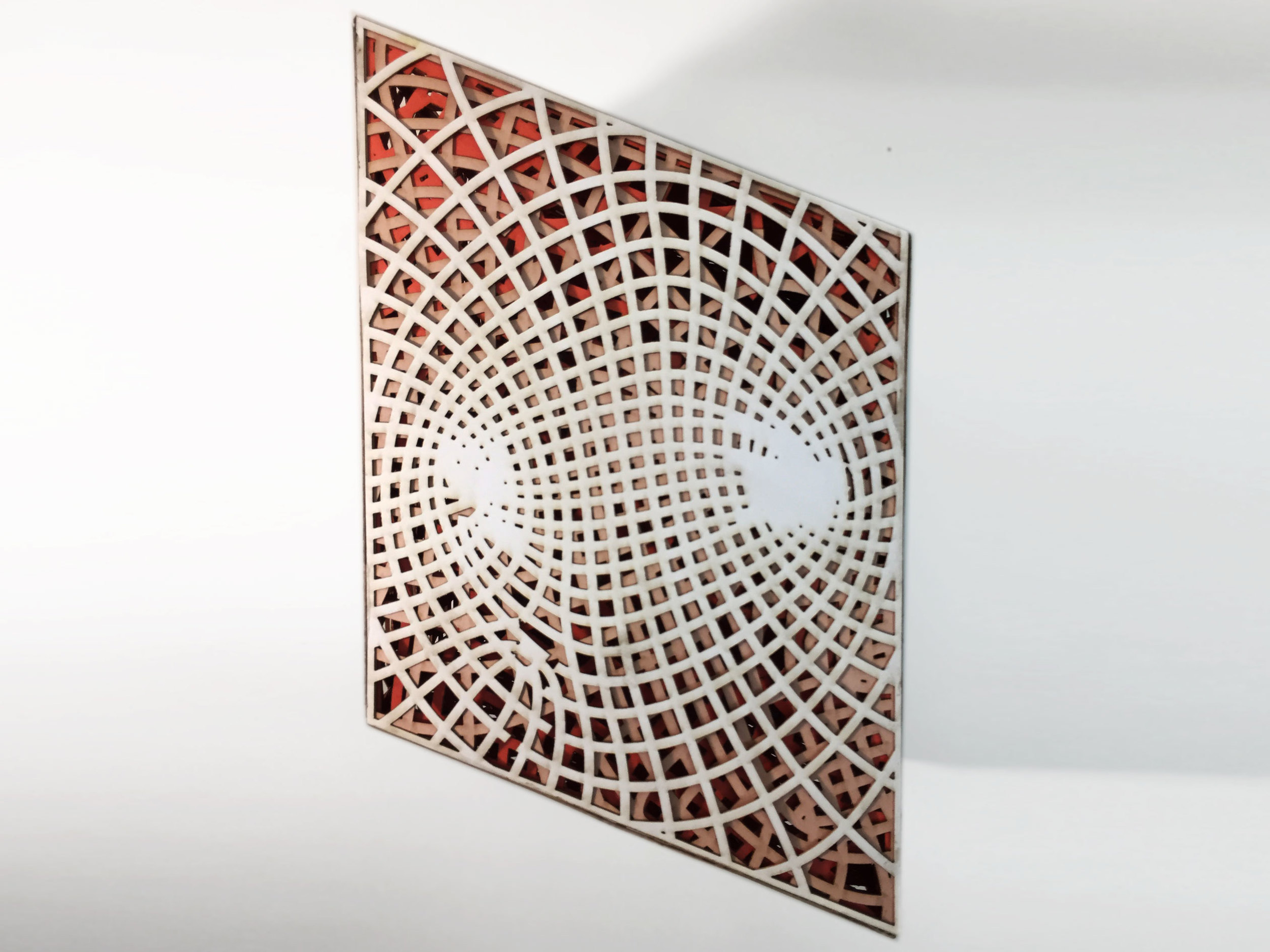 The first prototype was made of 3 layers of laser cut paper. Each layer represented the stress pattern of a single orientation of the stool. Each layer is week on it's own however the stool gains strength in its redundancy.