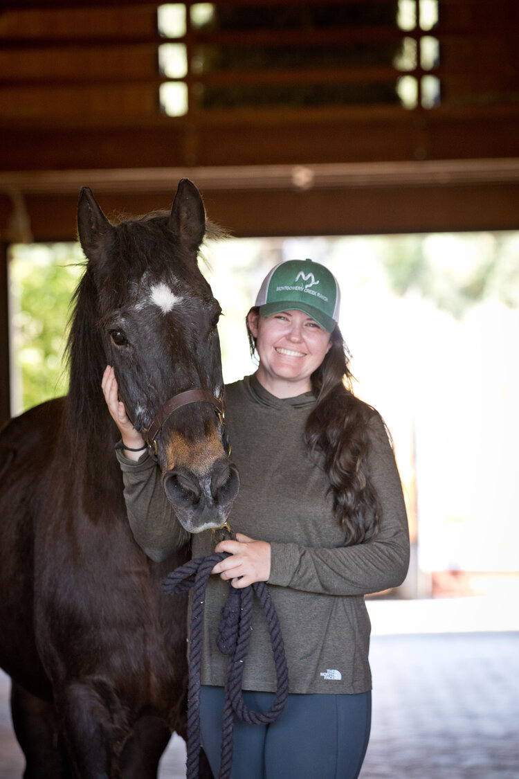 Brownie with MCR trainer Rachel, who saw him at auction. Photo by Tara Arrowood