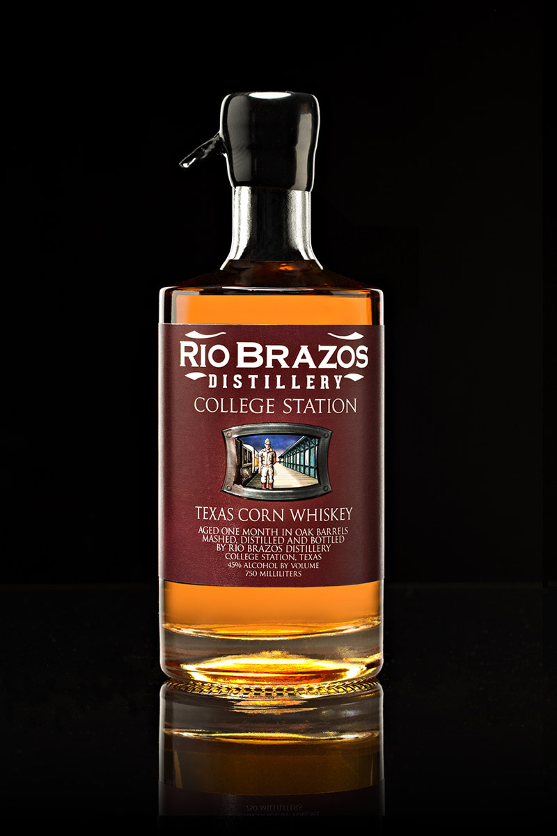 College Station Texas Corn Whiskey - We distill College Station from a bourbon mash that includes a helping of roasted malt. This imparts a heavy, chocolaty richness to the hearts of the final run. Once diluted to barrel-proof, it is stored in used 30-gallon barrels, the same deep-charred barrels that were used earlier to age our bourbon.