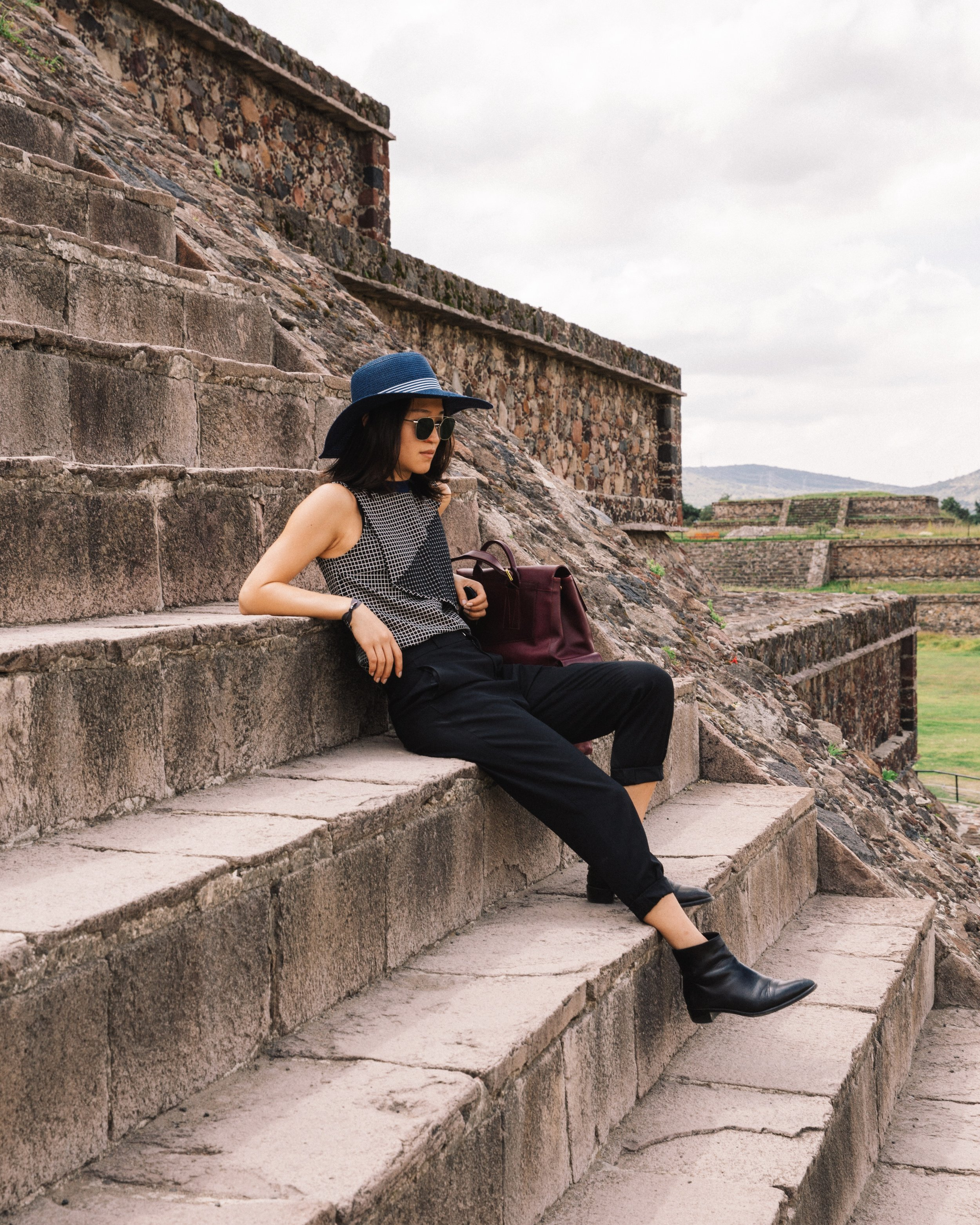 carven top, steven alan trousers, barneys ny leather boots, kent and curwen backpack, ahlem sunglasses, teotihuacan souvenir hat | photo by  Daniel Han