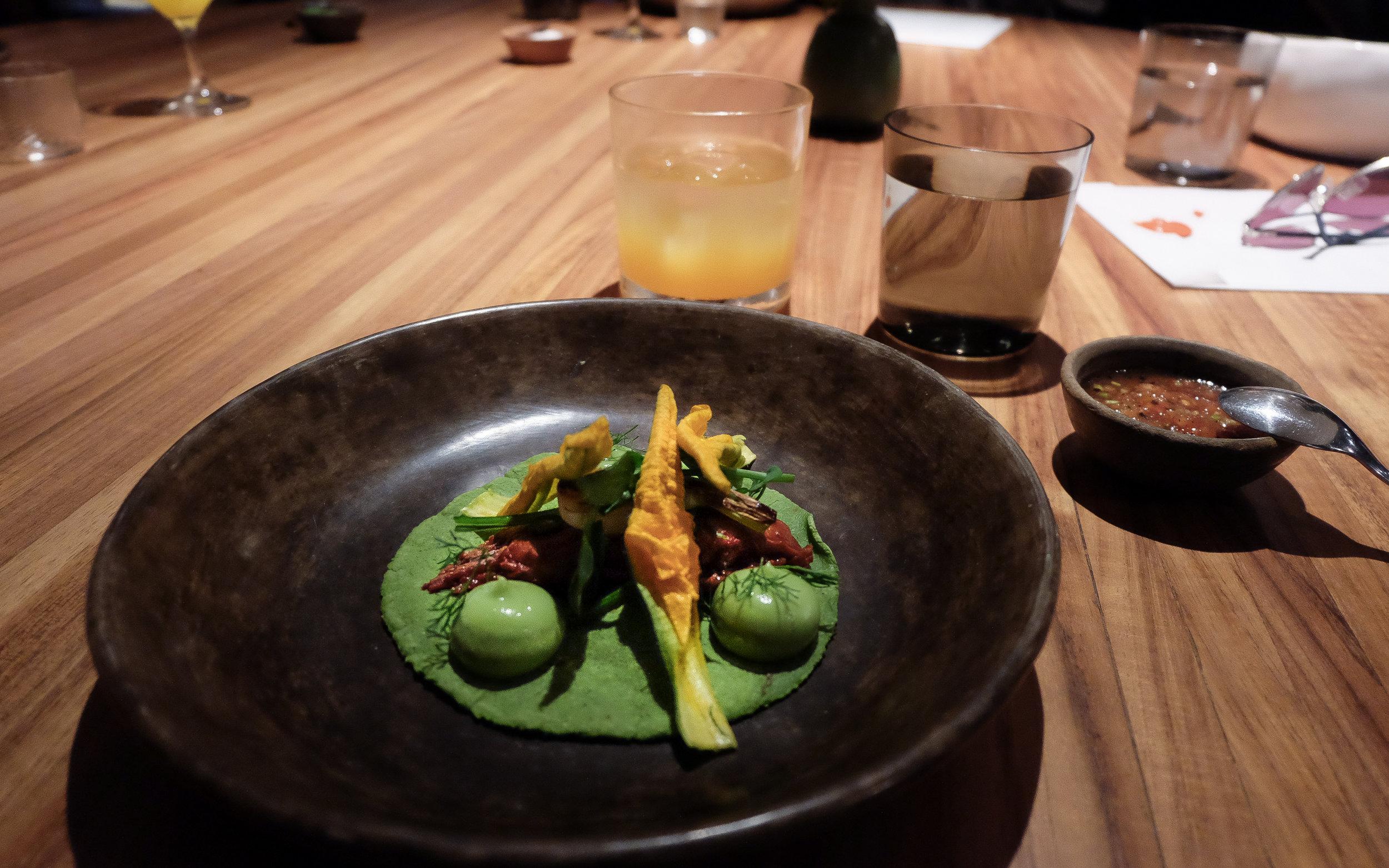III. Suckling lamb taco, avocado leaf adobo, avocado puree