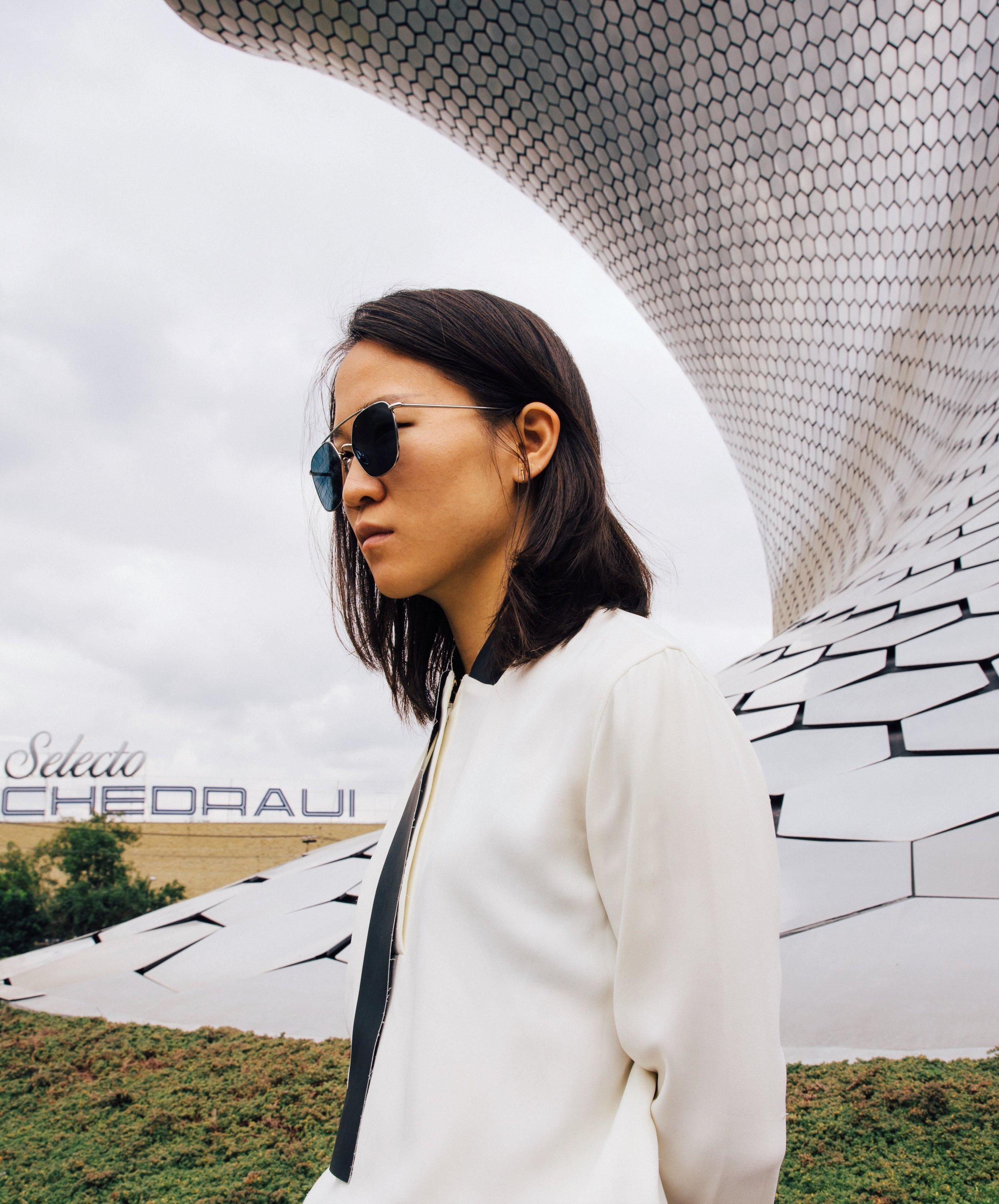 alexander wang blouse, ahlem sunglasses, loren stewart rod studs  photo by  Daniel Han