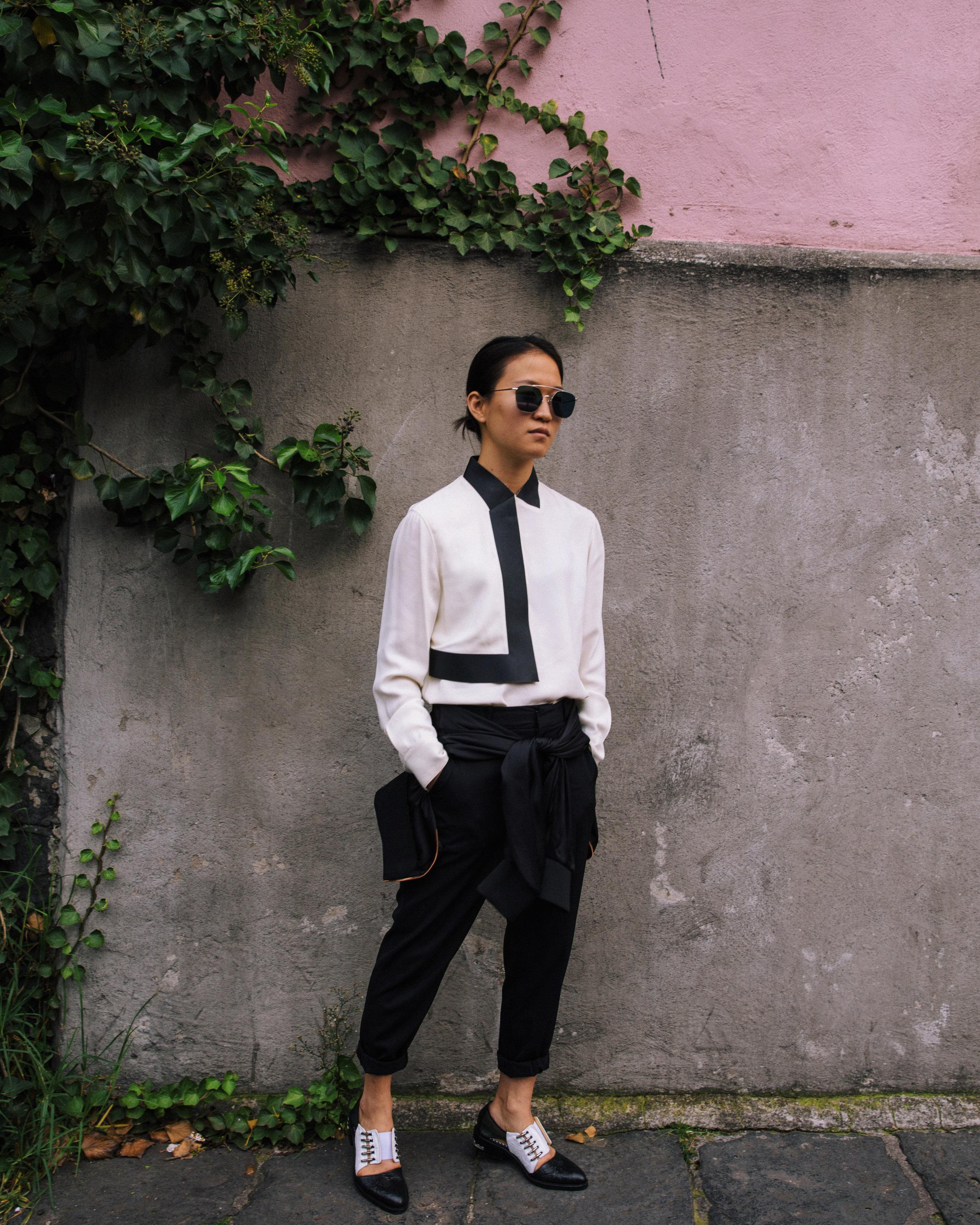 alexander wang blouse, steven alan trousers, zara cropped satin jacket (on waist), toga cut out shoes, ahlem sunglasses  photo by  Daniel Han