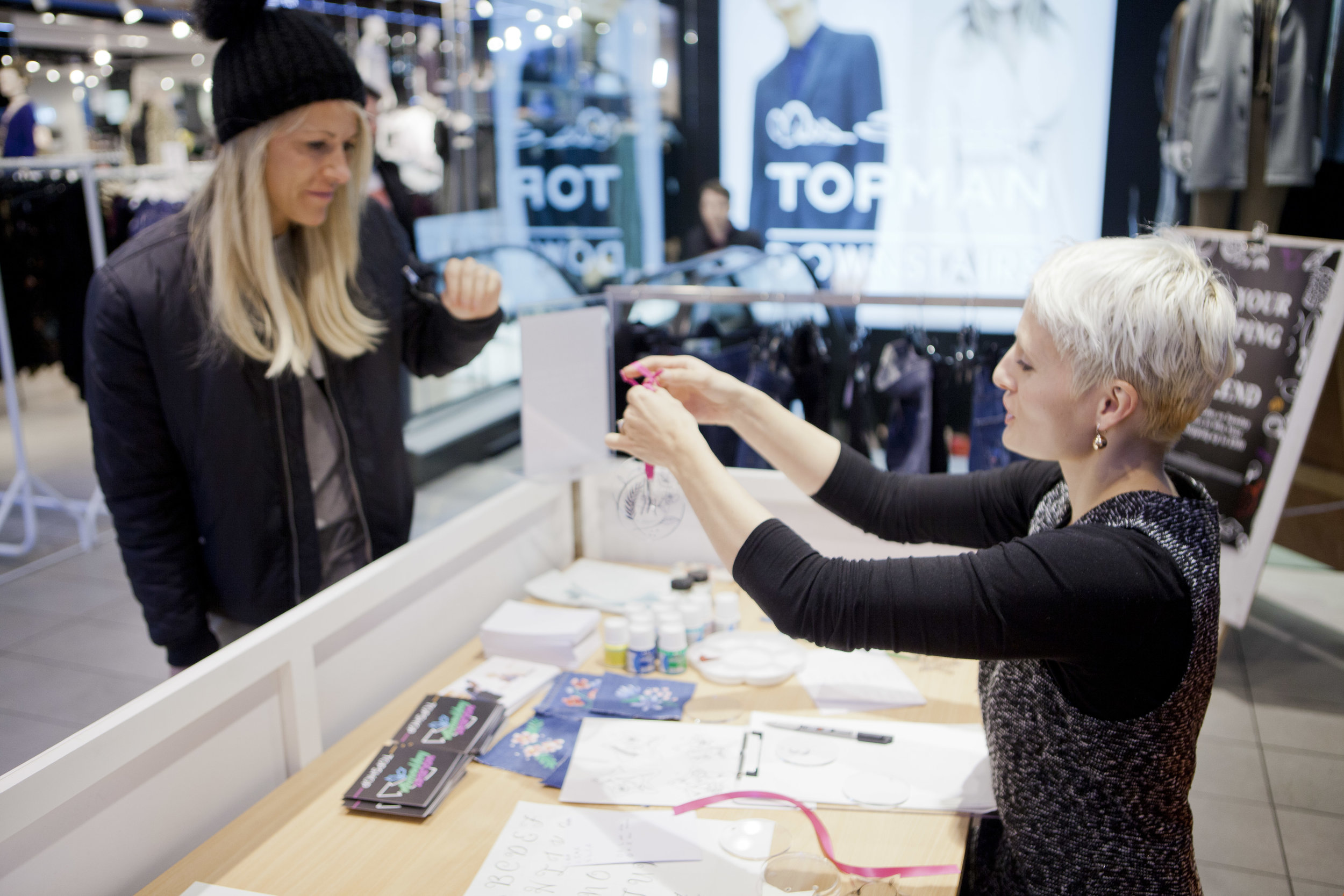 Hand drawn, personalisation of Christmas Baubles at Topshop