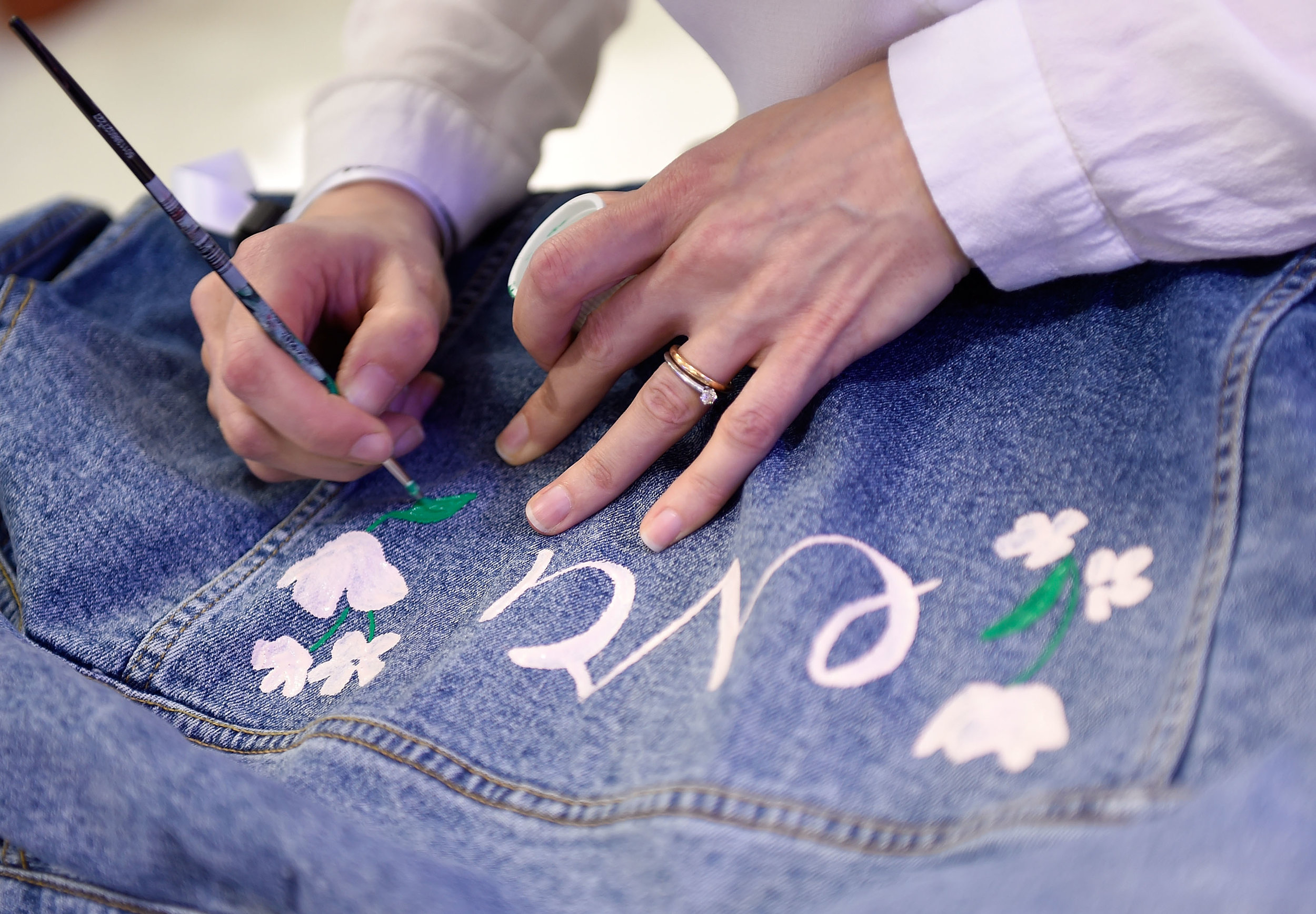 Willa Gebbie live illustration denim painting at John Lewis
