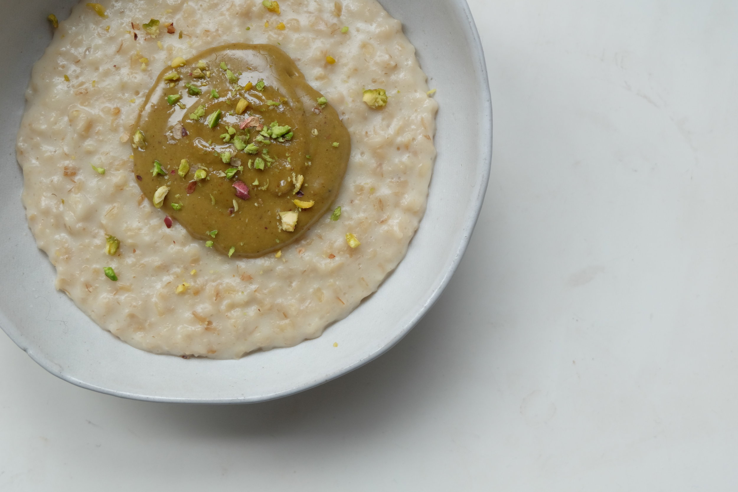 Double Oat Porridge with Homemade Pistachio Butter and Chopped Pistachios