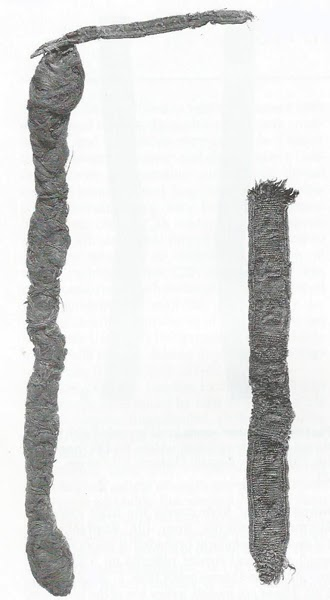 Textiles and Clothing: 1150-1450, pg 132. Silk filet with false hair attached.