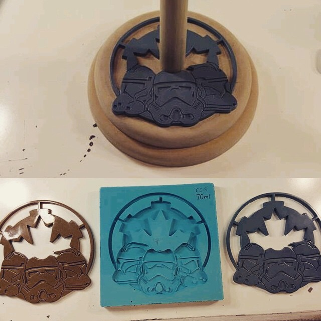 Here is the @ccg501stlegion helmet stand from the previous video post. Above photo needs some paint. Bottom photo is original router'd wood logo, center is silicone mother mold, right is first resin cast. Doing a resin cast is much more cost effective vs time it takes to router a wooden copy.