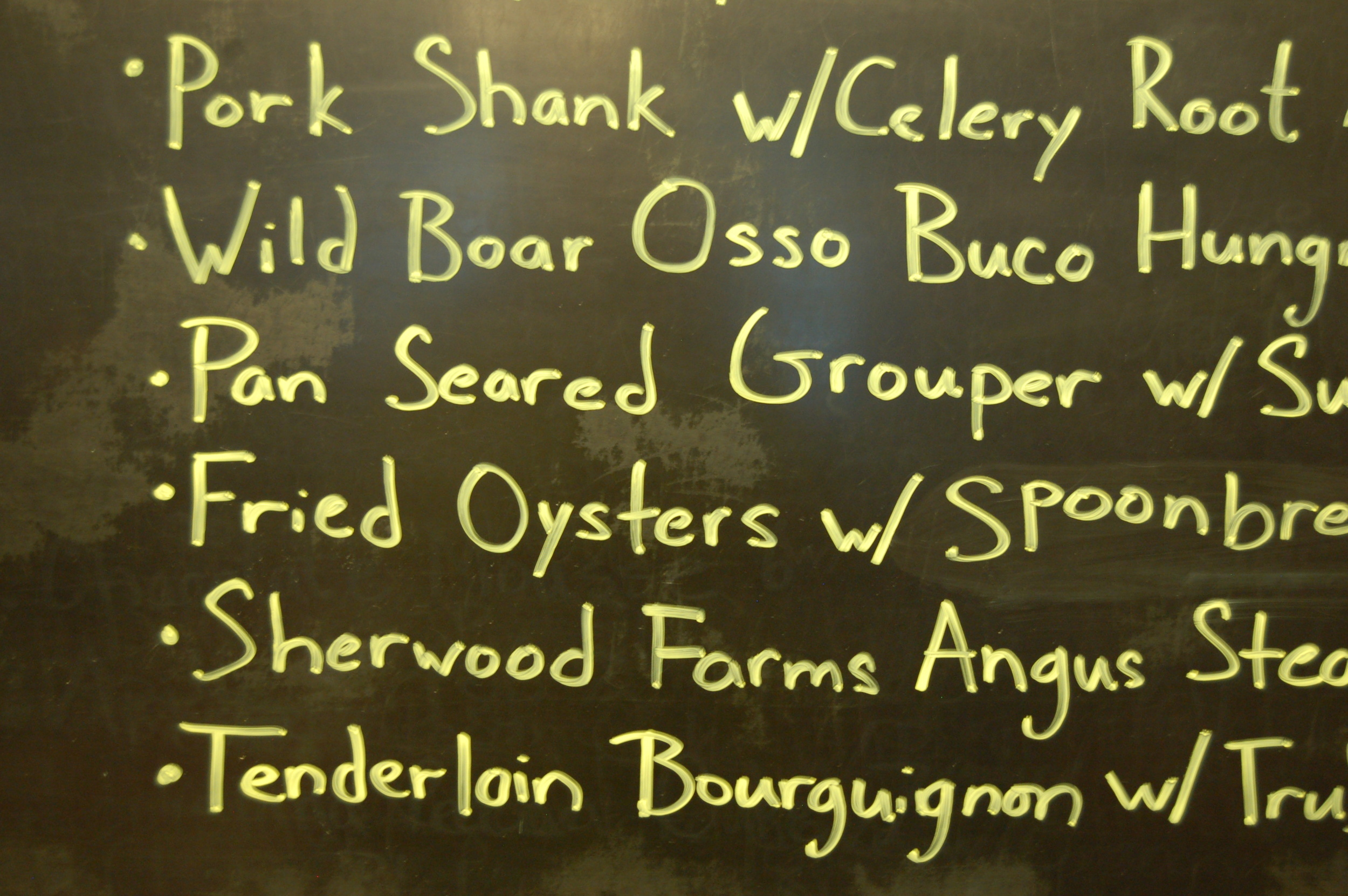 What you really want to know about the menu at Tastings of Charlottesville is on their blackboard.