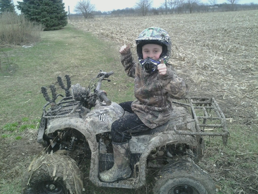 Braedan out Mudding on his 4-wheeler. One of his favorite things to do out doors.