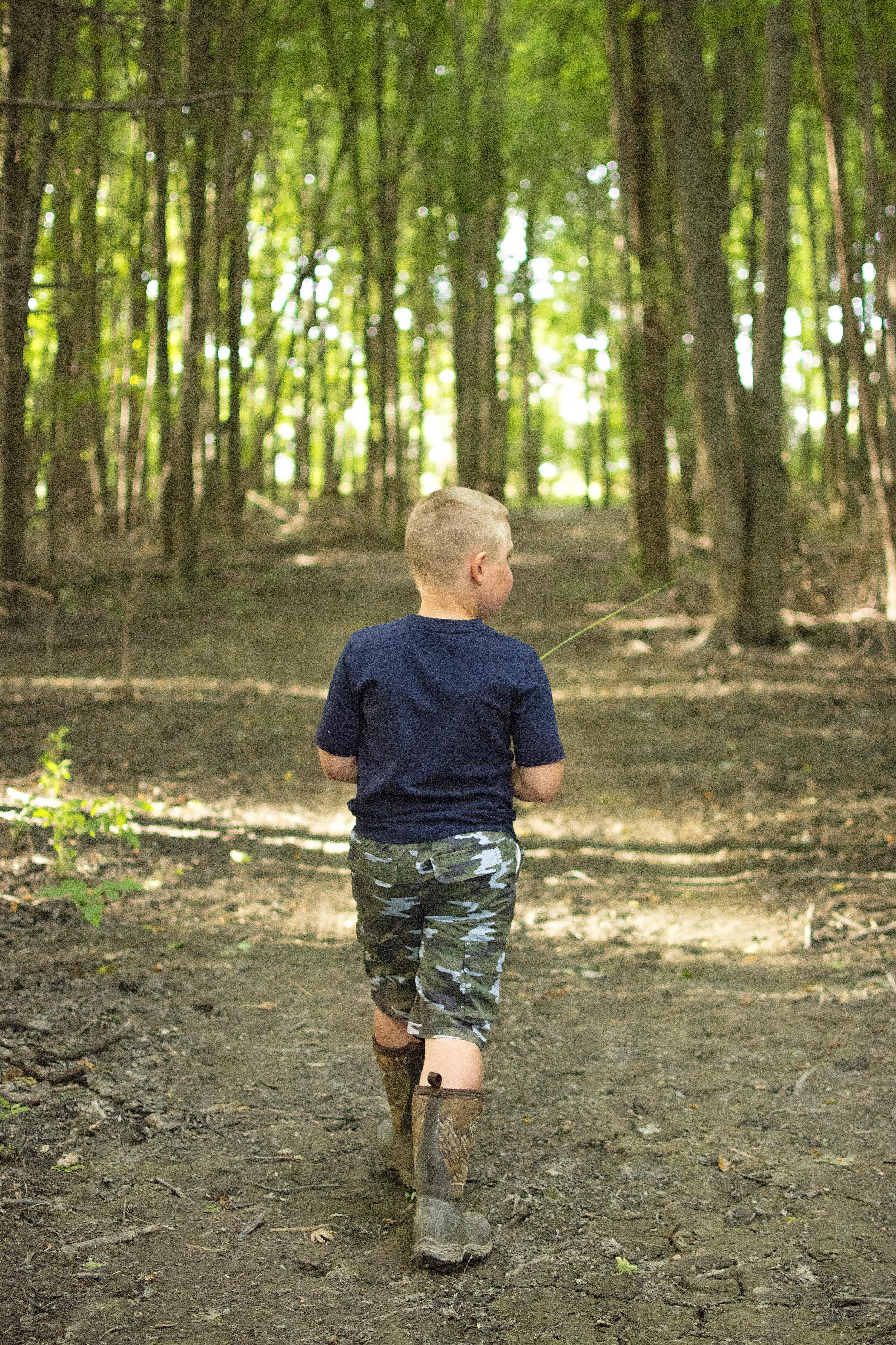 One of Braedan's favorite things to do, exploring the woods.