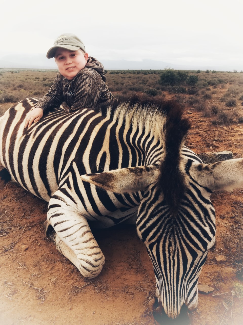 Braedan and Zebra.jpg