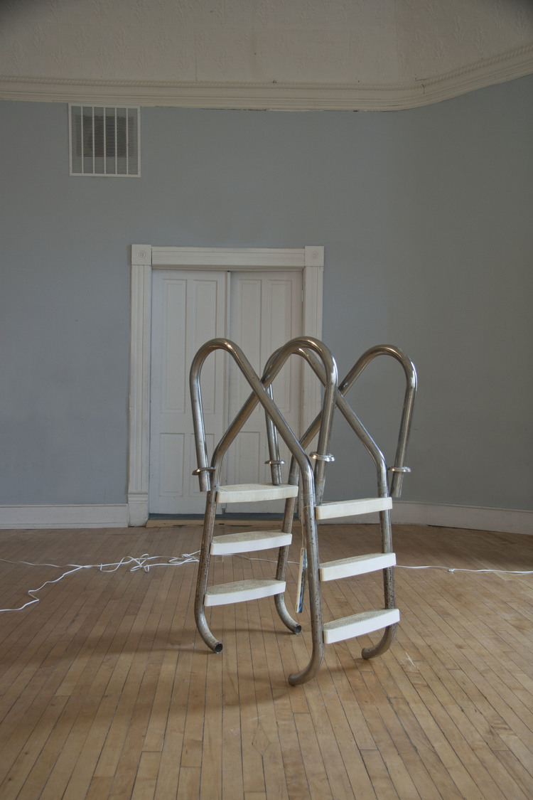 Installation view of Thank Me Ladder, 2014, by Kristina Banera at Junkhaus 1.  Exhibition features work of Alex Atteah, Kristina Banera, Hannah Doucet, Jessica Evans, John Patterson, Daniel Romphf, and Rachael Thorliefson.