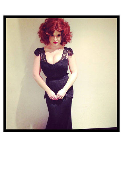 Osbourne impersonates the Mad Men star, Christina Hendricks, with fire-red locks and a vintage lace dress.jpg