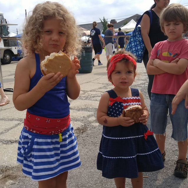 Can you tell which unhappy looking kid didn't get an ice cream sandwich of his own?
