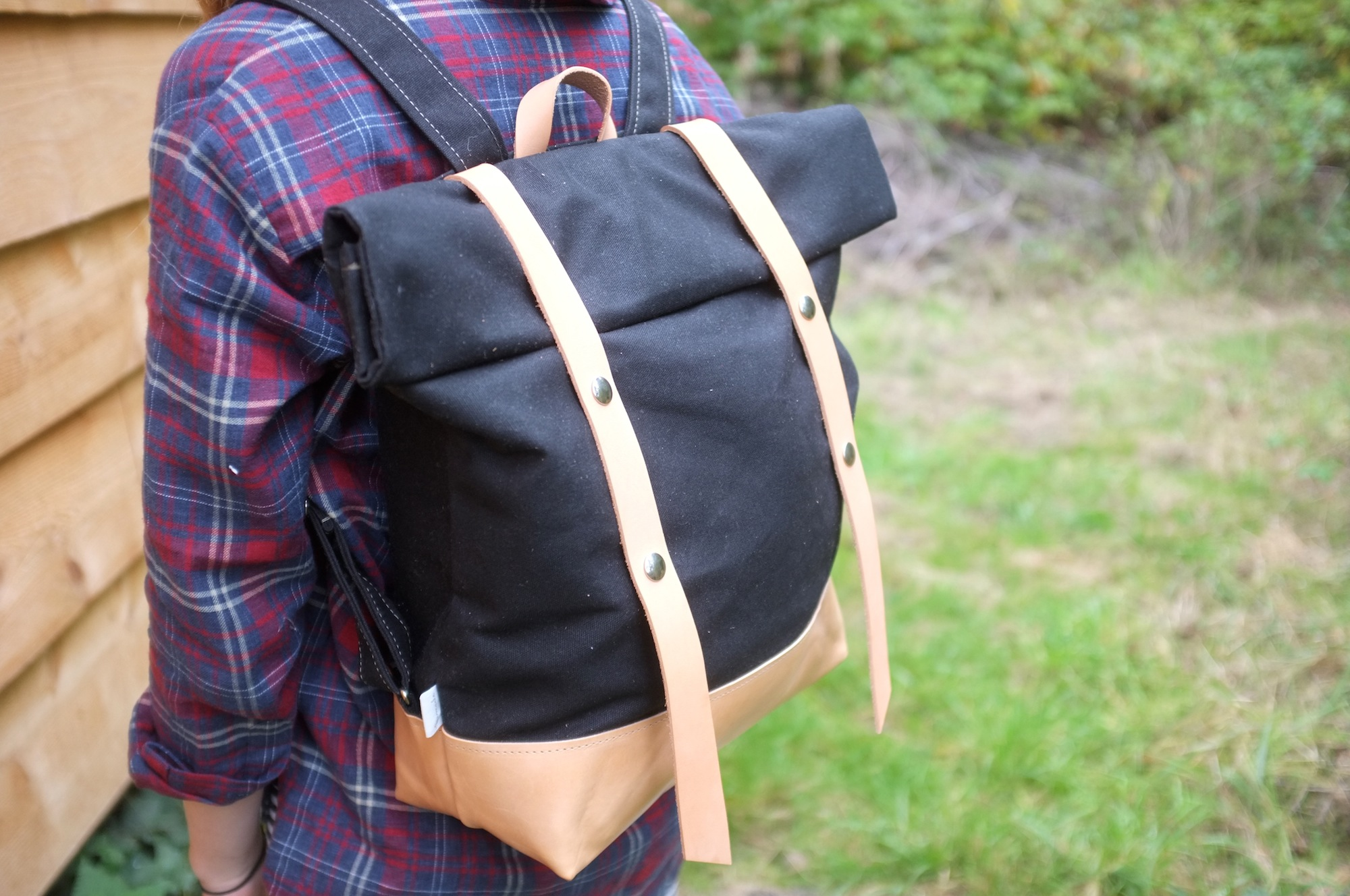 The Black Waxed + Leather Snap Pack for sale only  here.  More rucksacks coming in November...