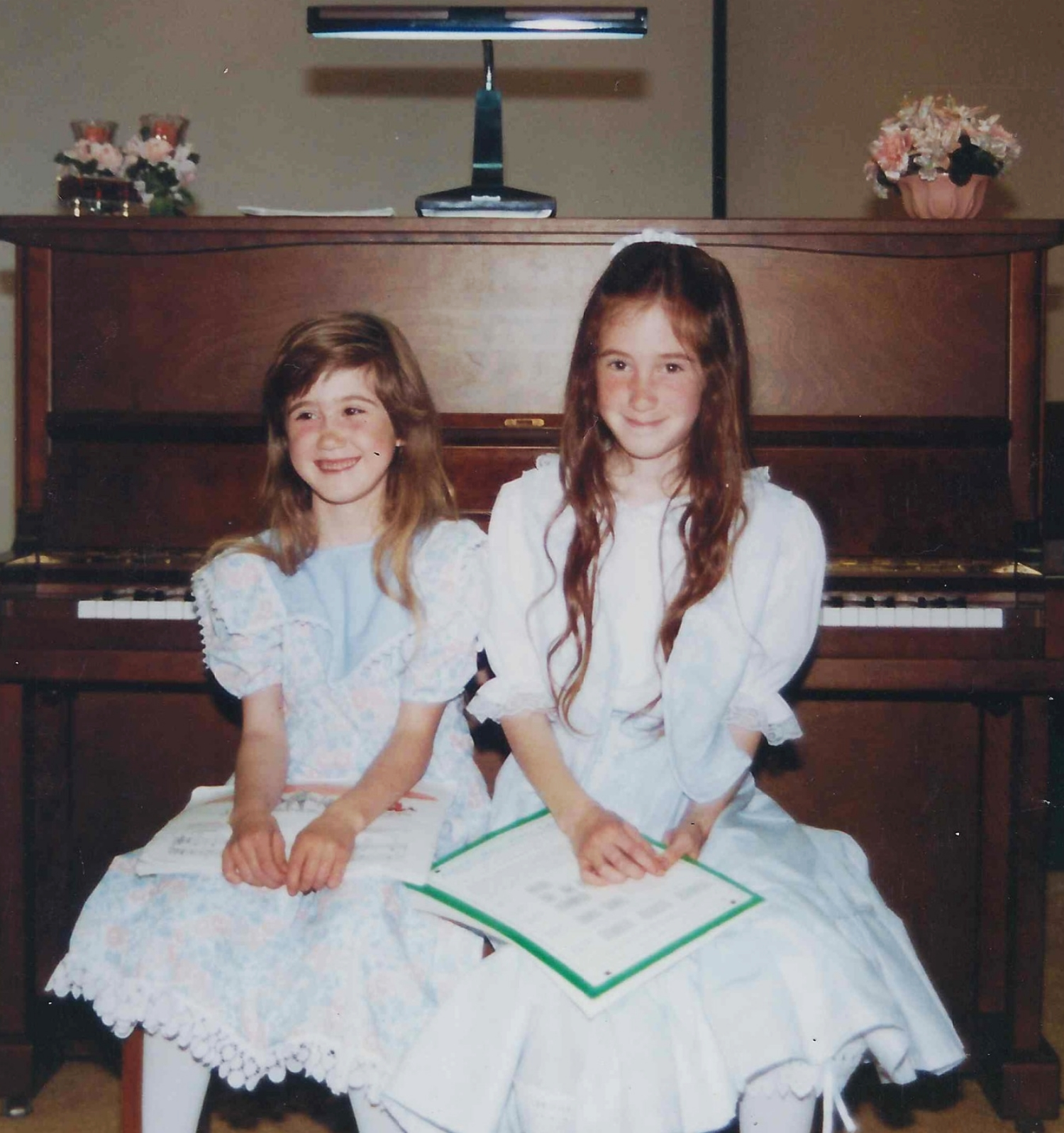 Josie and her sister Joya at a piano recital. (age 9)