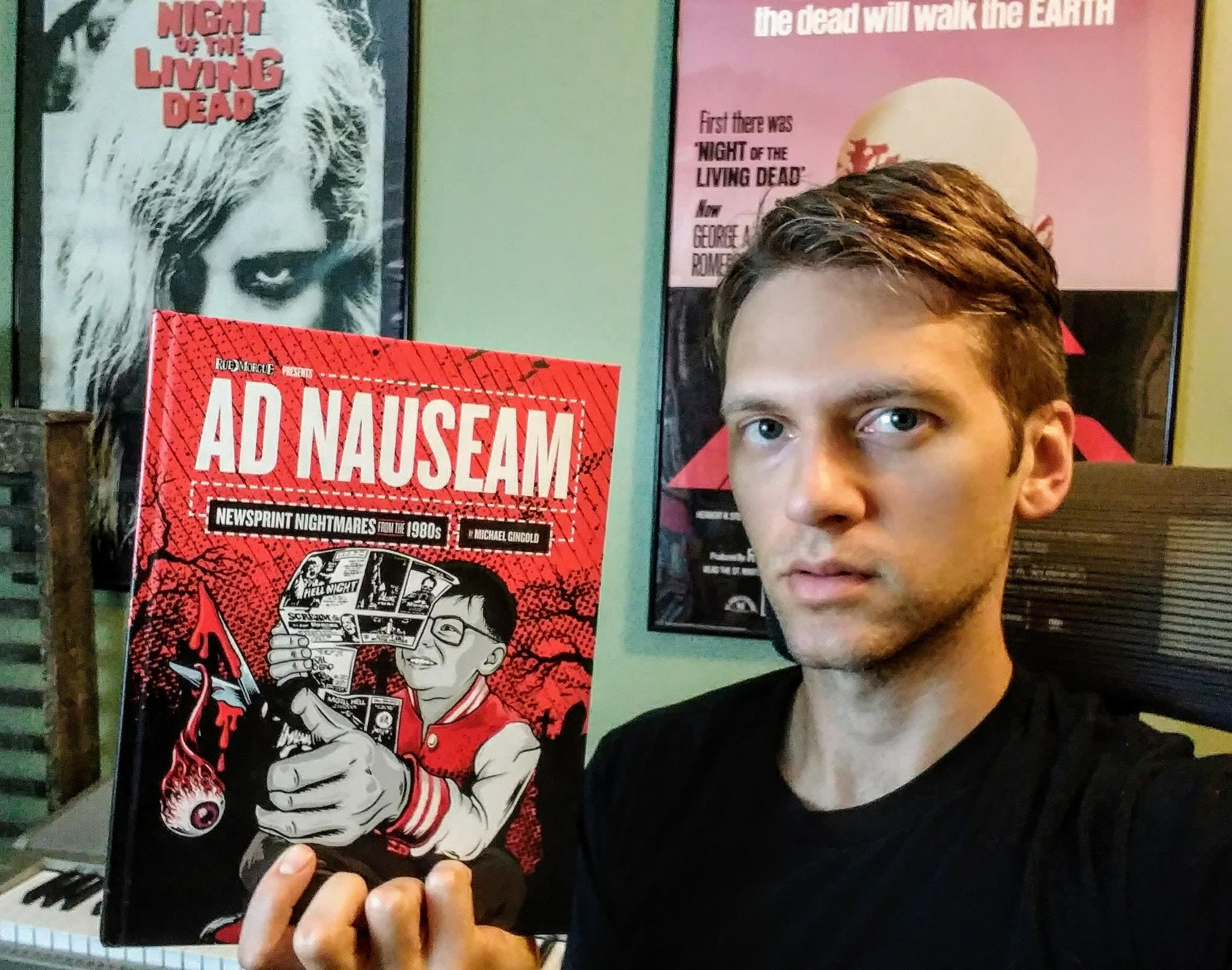 "Holding my copy of ""Ad Nauseam""."
