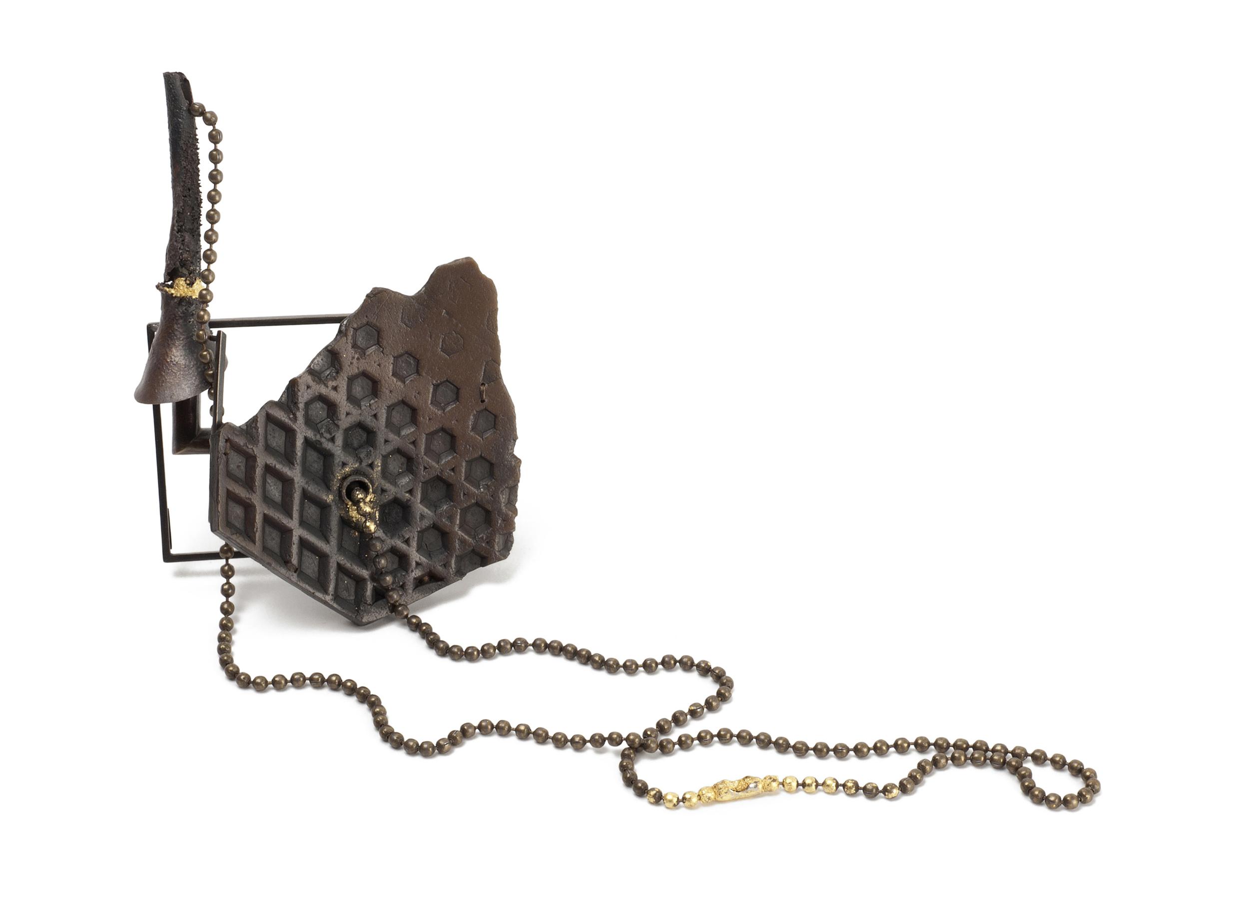 """Bottom Feeder (brooch), 2014. Rubber shoe sole, brass, copper, steel, thread, graphite, 23k gold. 4.25"""" x 3"""" x 1.5"""" (25"""" chain)"""