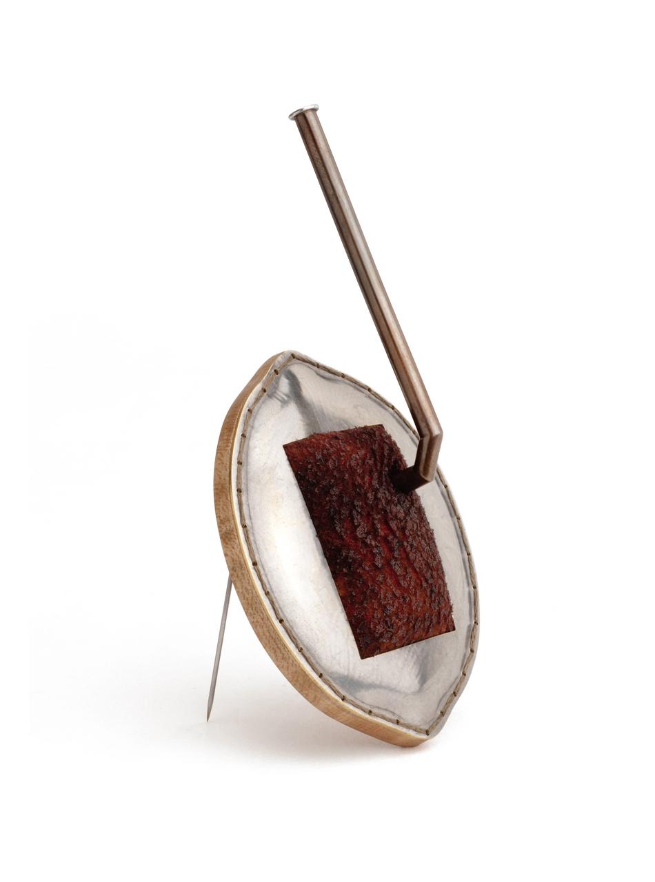 "Stocking Stuffer  (brooch), 2014. English silver, memory foam, maple, brass, steel, thread, sterling silver, graphite, bloodwood. 4.25"" x 2"" x 1"""