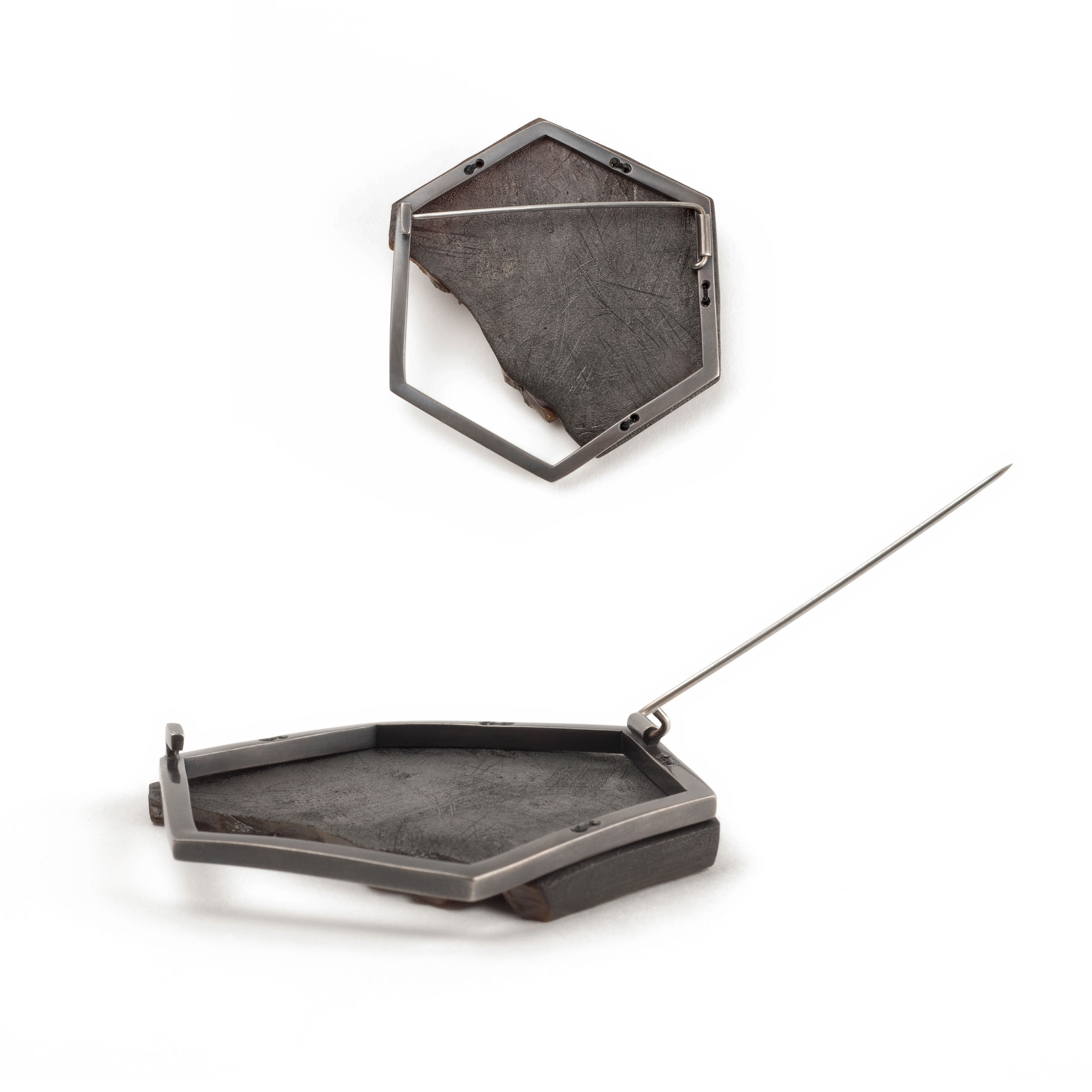 """Rubber Sole Brooch  (pin back details), 2015. Shoe sole, sterling silver, steel, silk thread, graphite, 23k gold-custed crud. 2.25"""" x 2"""" x 0.25"""""""