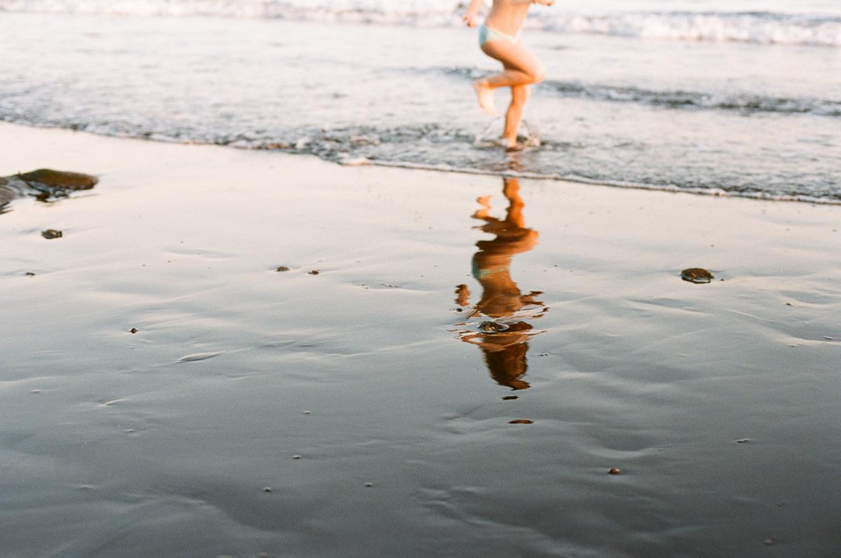 A little girl runs on the beach near Lovina, North Bali. Photograph on Portra 400 film by Erica Knecht, a Kuala Lumpur based Photographer.
