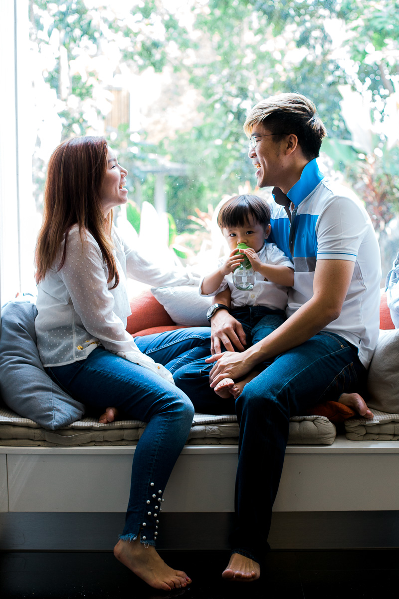 A young family enjoy each other's company at home in Kuala Lumpur.