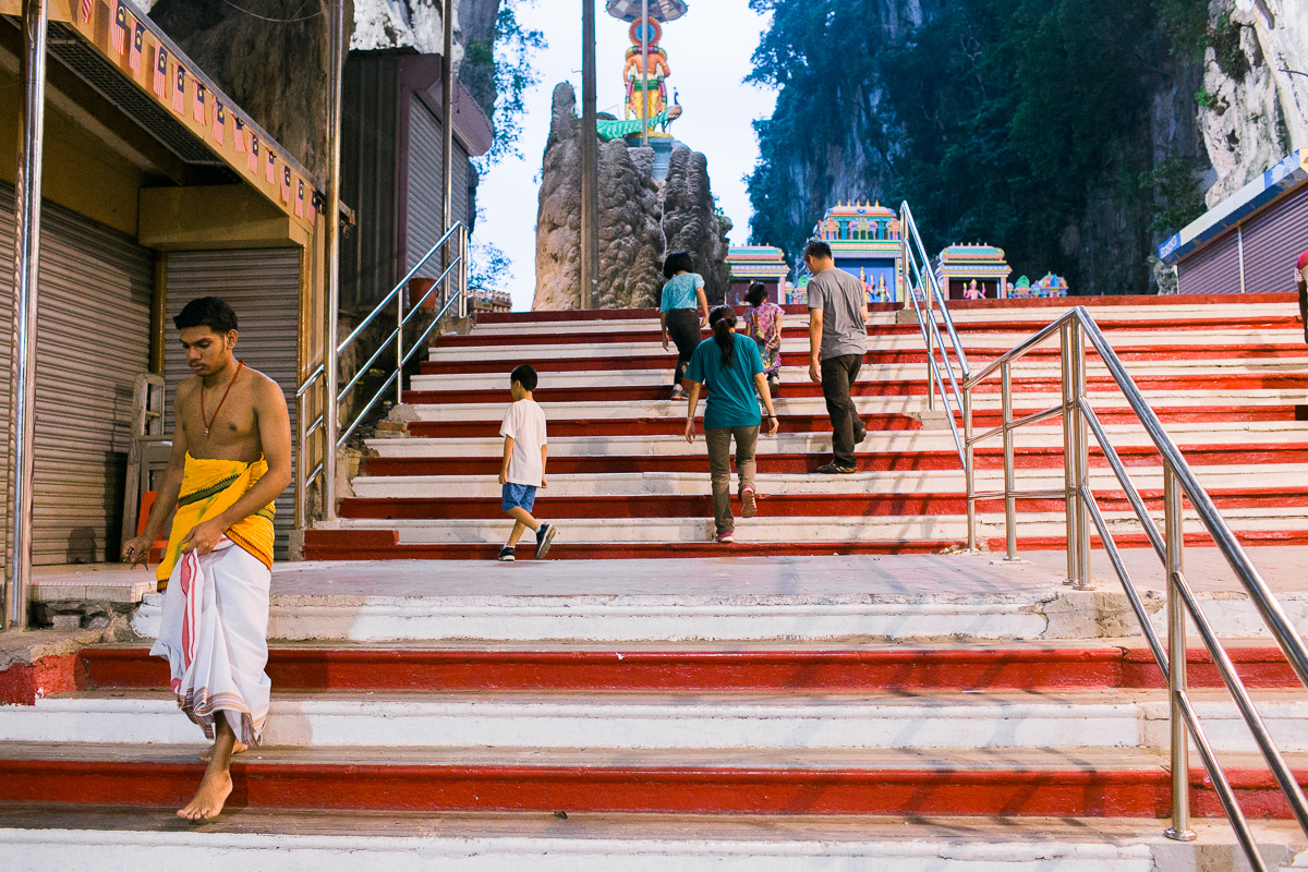 A worshiper descends the steps at Batu Caves.
