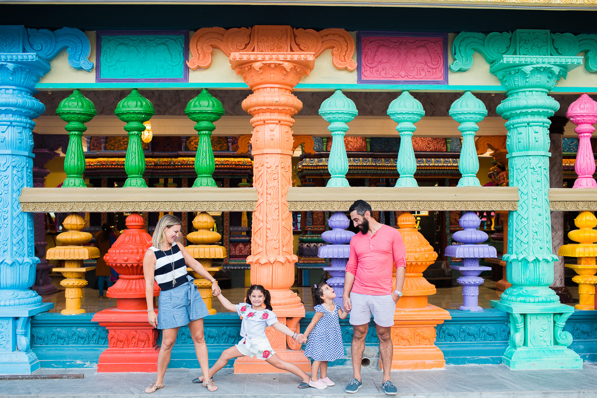A family portrait in front of a colourful temple in Kuala Lumpur.