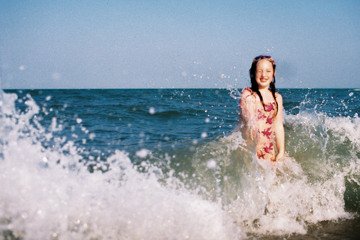 a girl plays in the waves - kuantan beach - film - erica knecht - kuala lumpur photographer