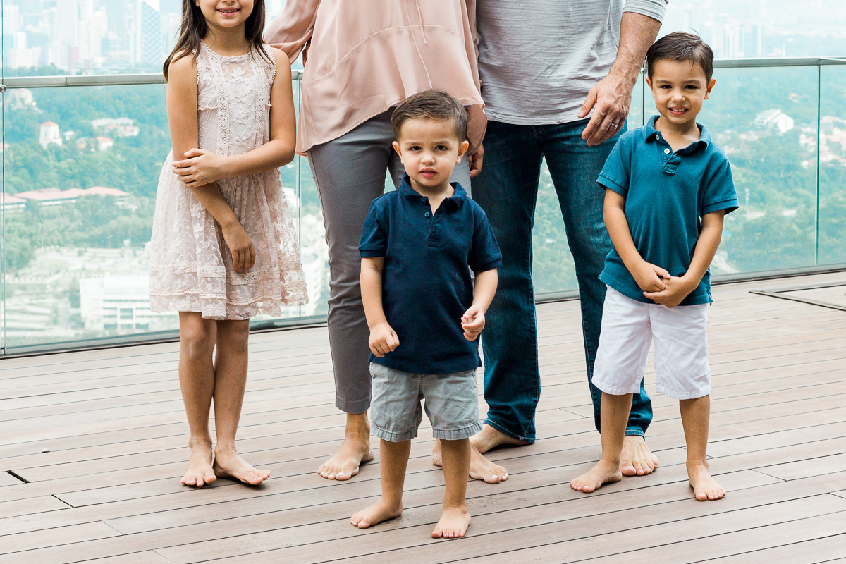 Three children give the camera a hard state by Kuala Lumpur family photographer Erica Knecht