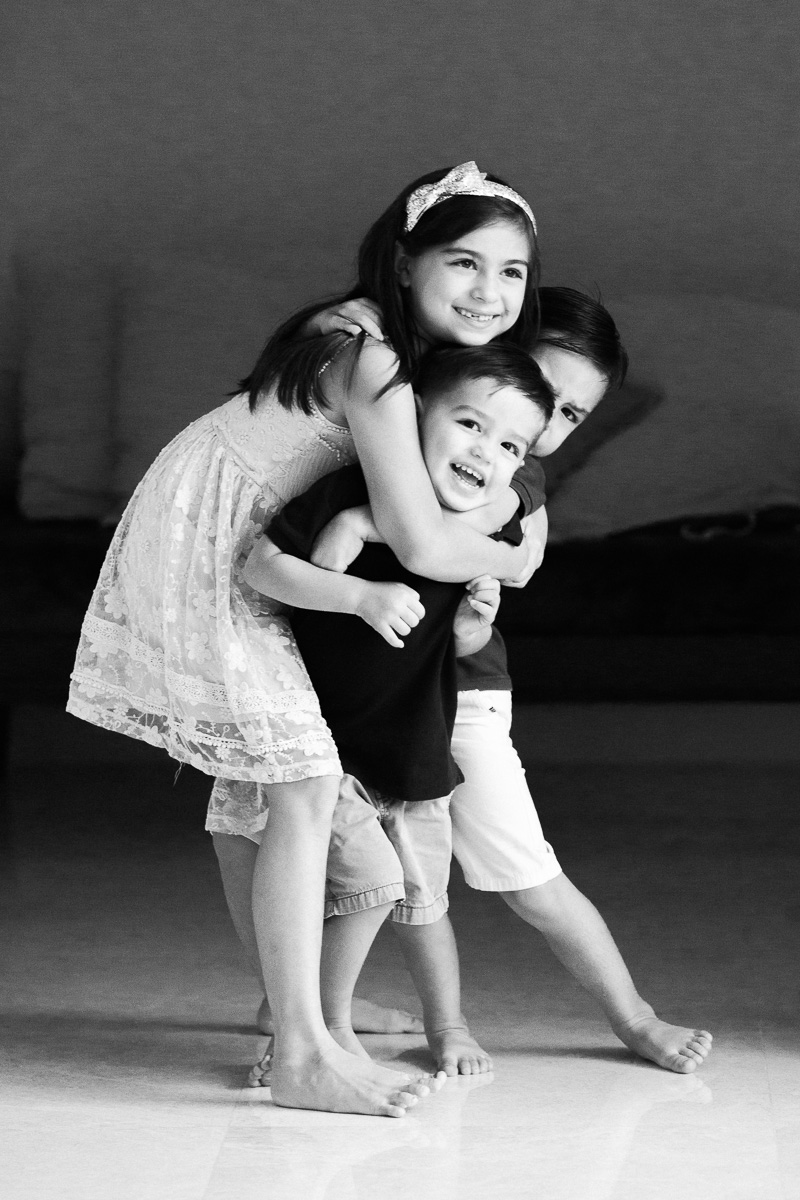 three kids cuddle / headlock during a family photography session in Kuala Lumpur