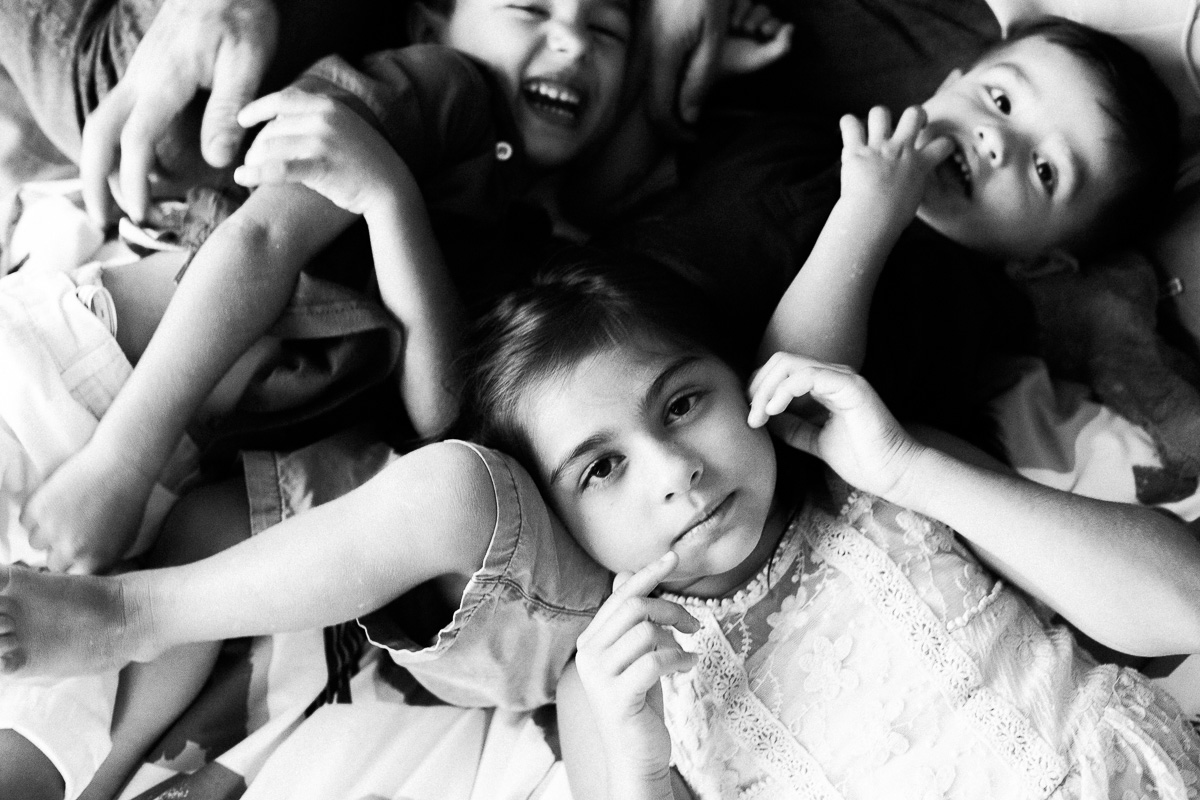 three beautiful children look at the camera during a family photography session in Kuala Lumpur.
