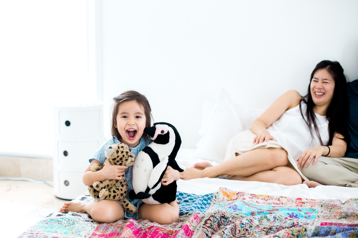 An n exuberant girl poses with her stuffed animals in Jakarta