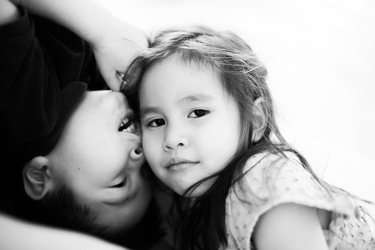 a brother and sister cuddle by asia family photographer erica knecht