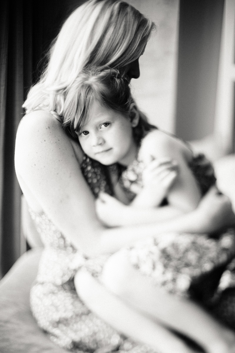 A freelens image of a mother cuddling her daughter