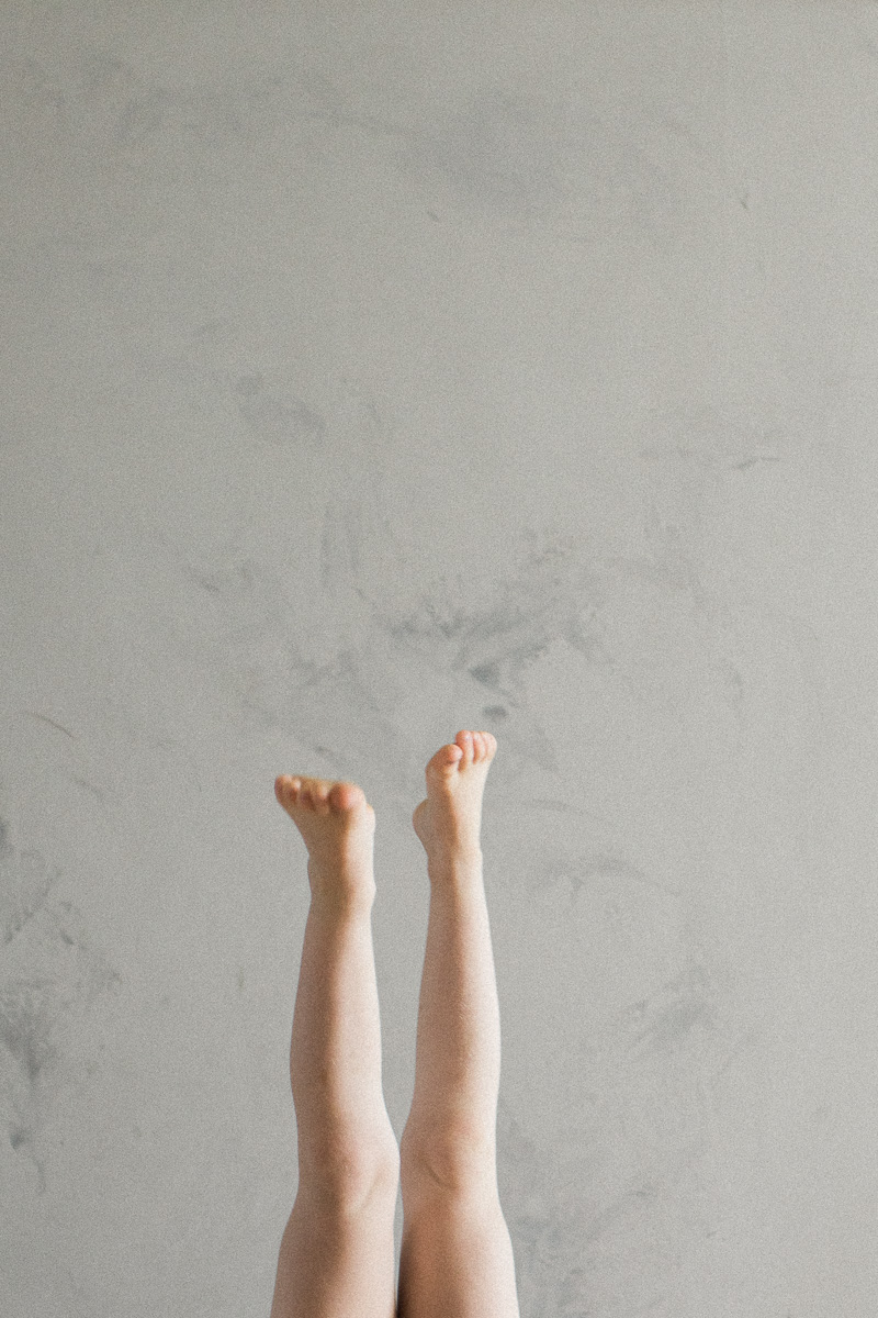 A girl does handstands