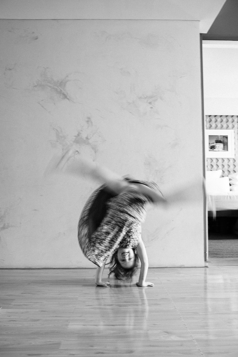 a girl does cartwheels during a lifestyle family shoot by Kuala Lumpur photographer