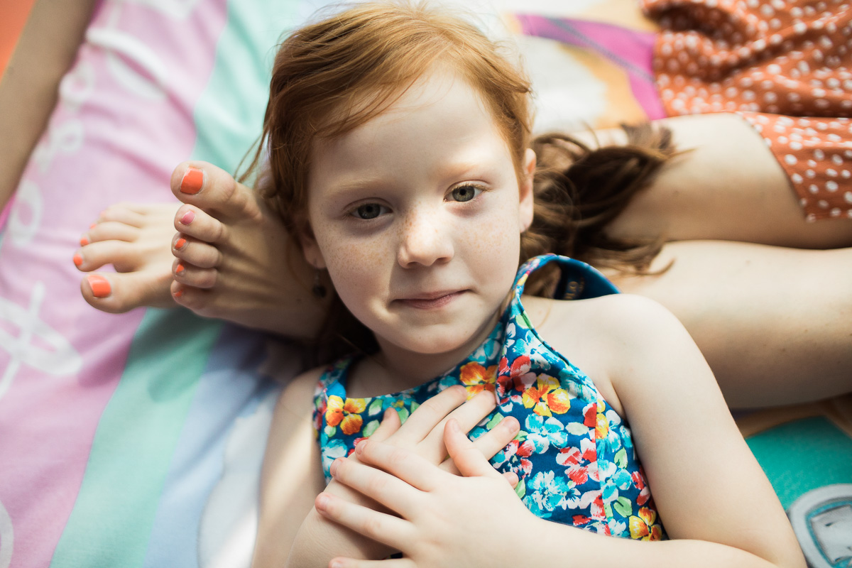 a portrait of a girl with red hair by Kuala Lumpur family photographer Erica Knecht