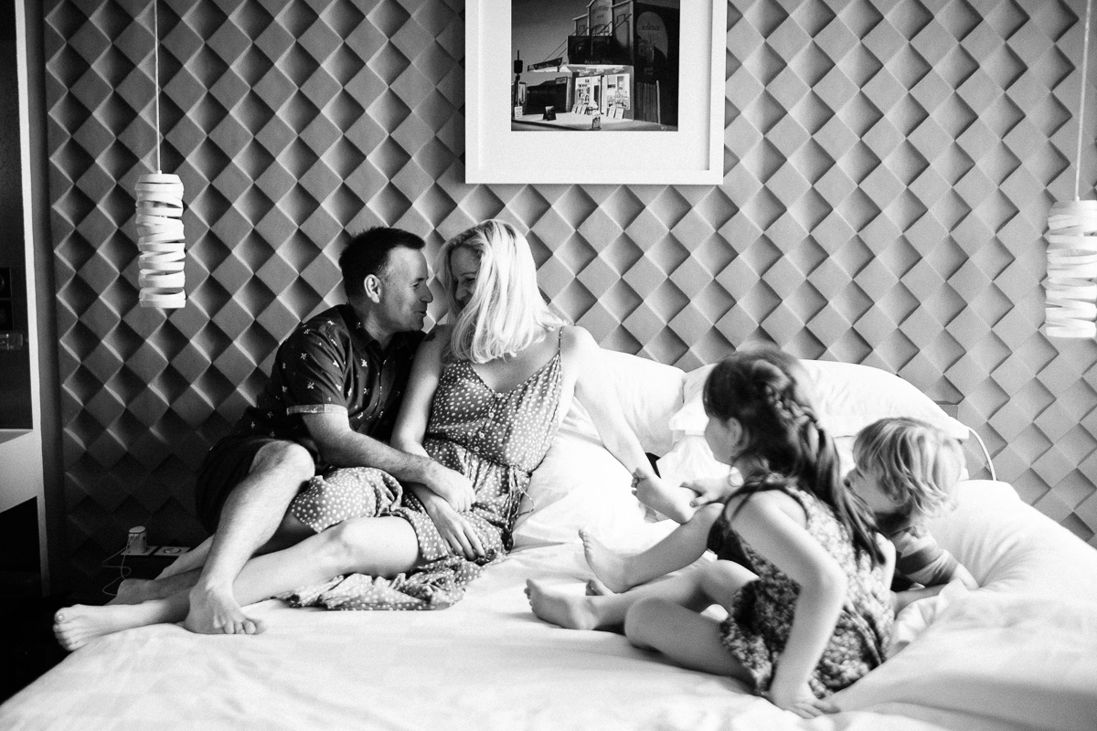A young family cuddle in bed by Kuala Lumpur Based lifestyle photographer