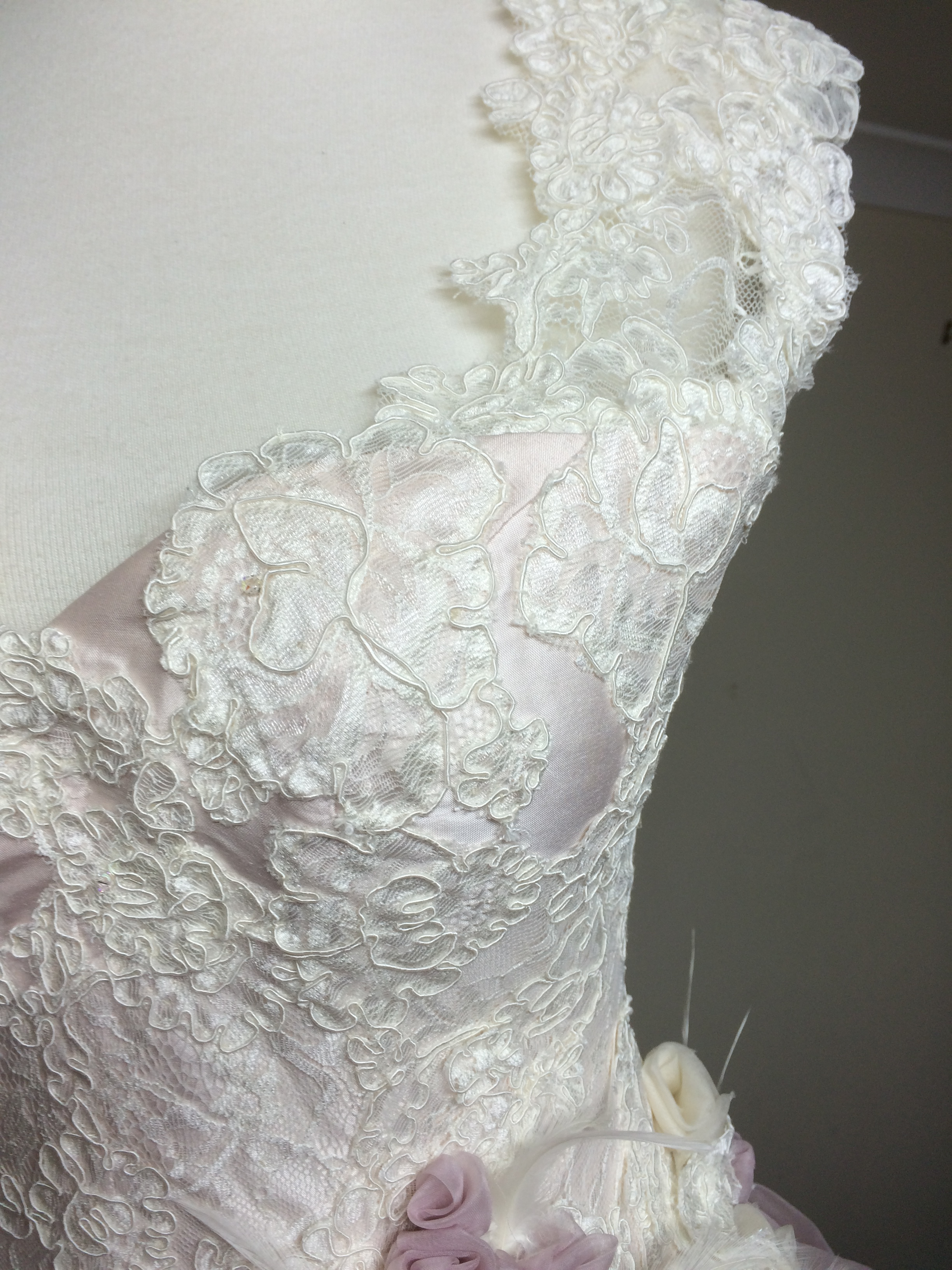 All the lace is fitted to the gown and then stitched by hand into place, leaving no seam lines to destroy the effect of the lace.