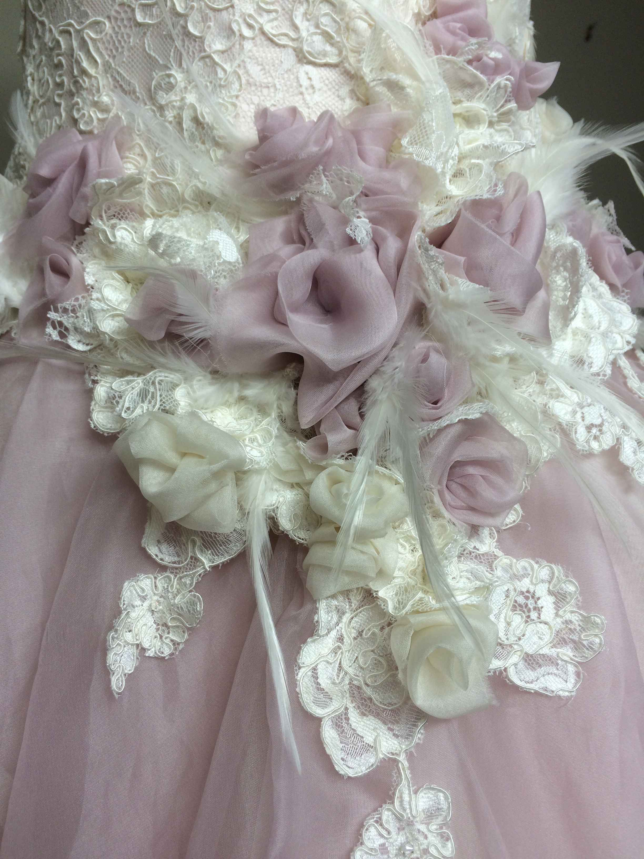 I'm very tactile and love the current bridal trends, allowing me to mix Dupion and organza silk, corded lace, hackle feathers, Swarovski bicone AB crystals and ivory/pink ombre, to create this wonderful merriment of a garden for my garden bride.