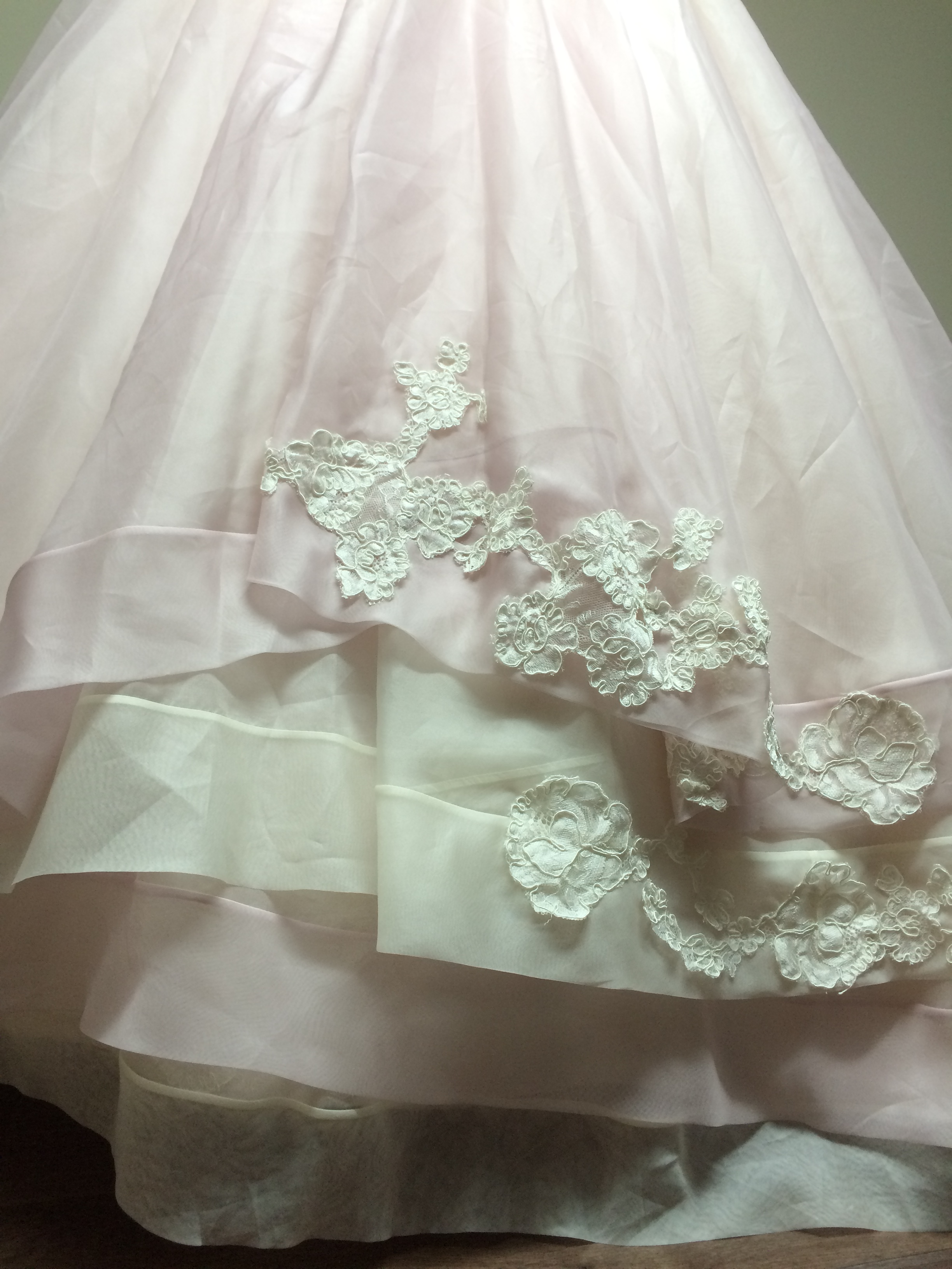 Finishing off the layered silk organza skirt hems with a scattering of lace.